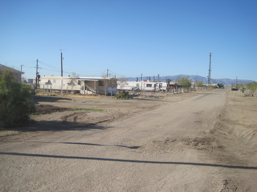 A dusty dirt road in Bombay Beach.