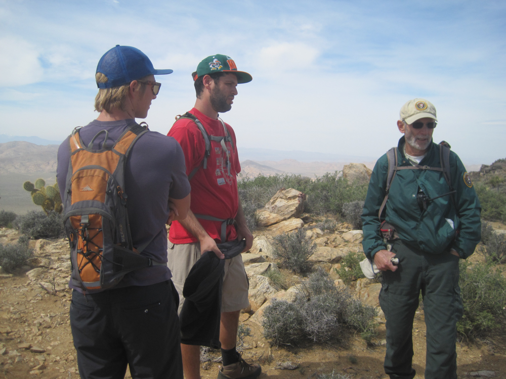 Speaking with a park ranger volunteer on top of Ryan Mountain.