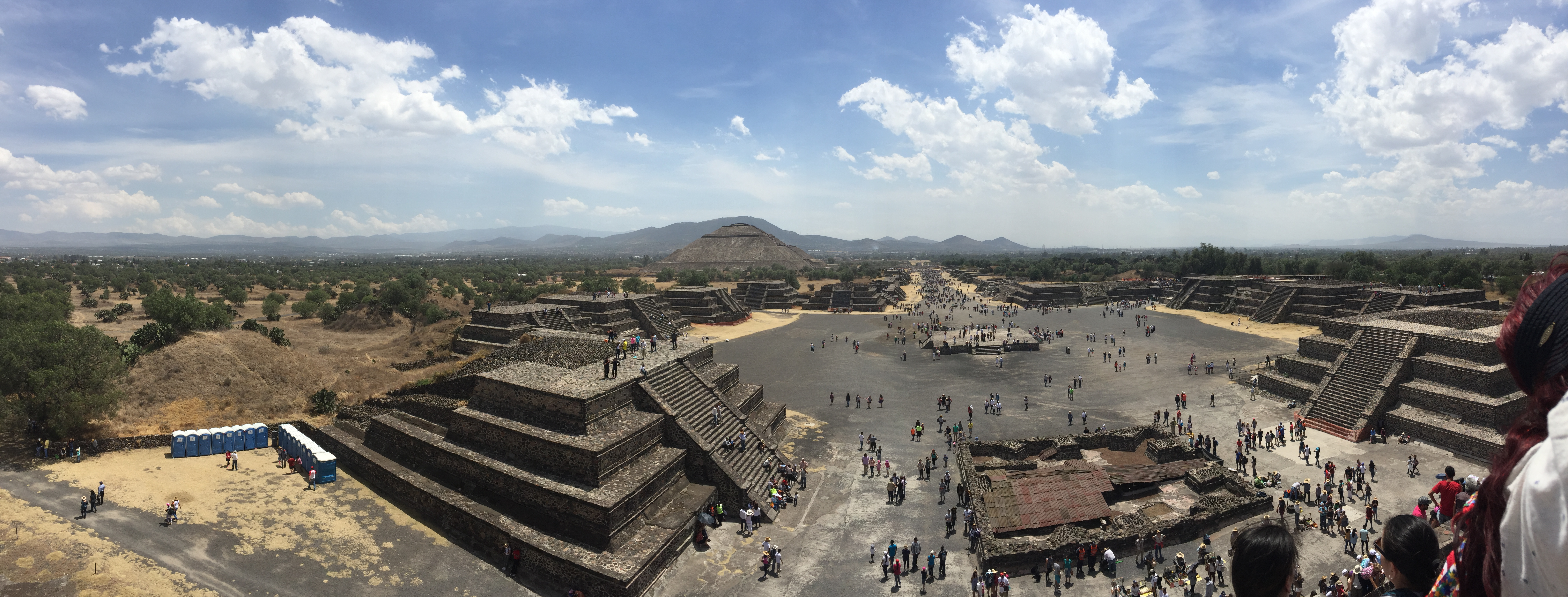Tourist roam about the pyramids at Teotihuacan.