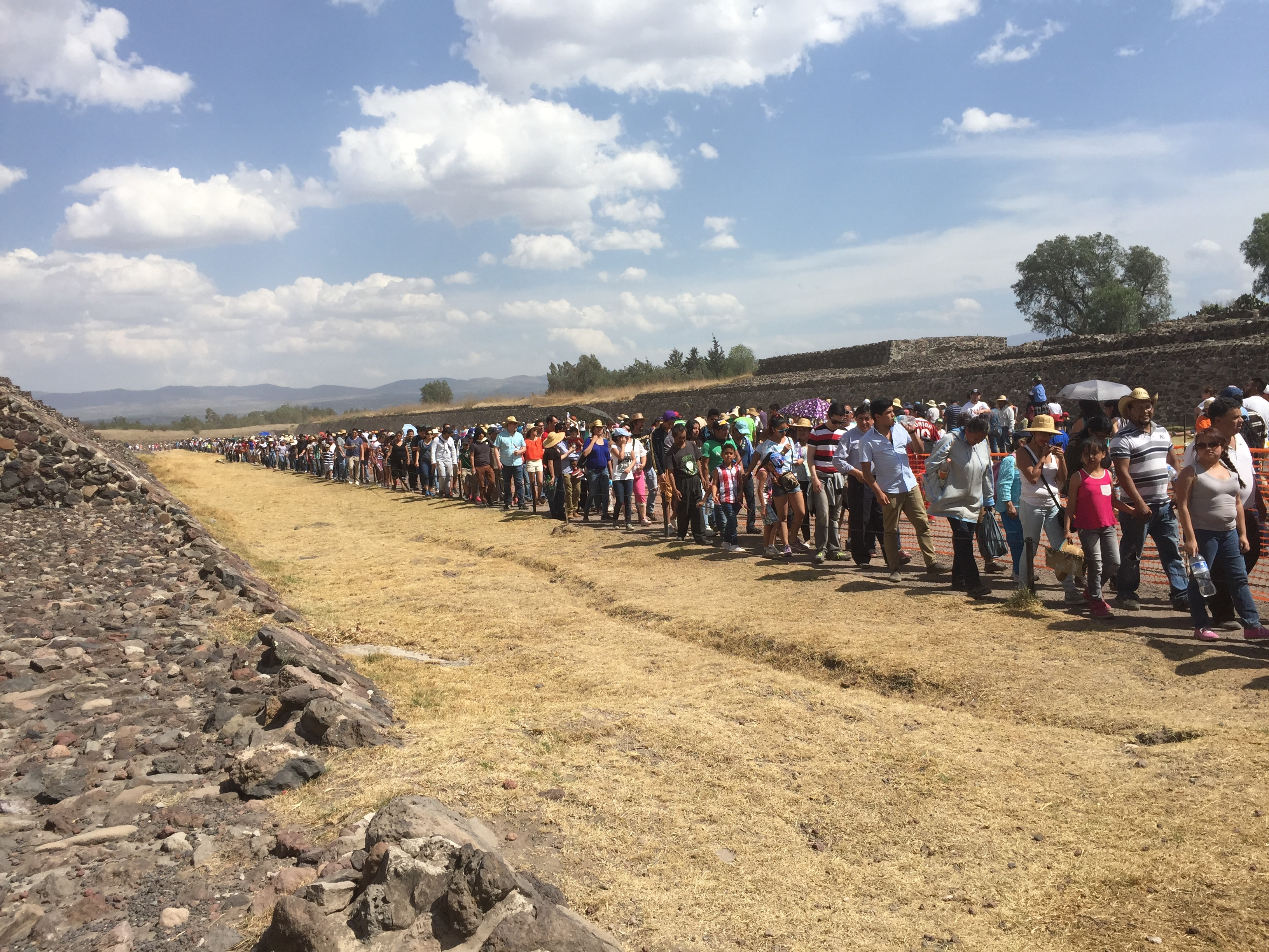 Tourists wait in line to climb the pyramid of the sun in teotihuacan.