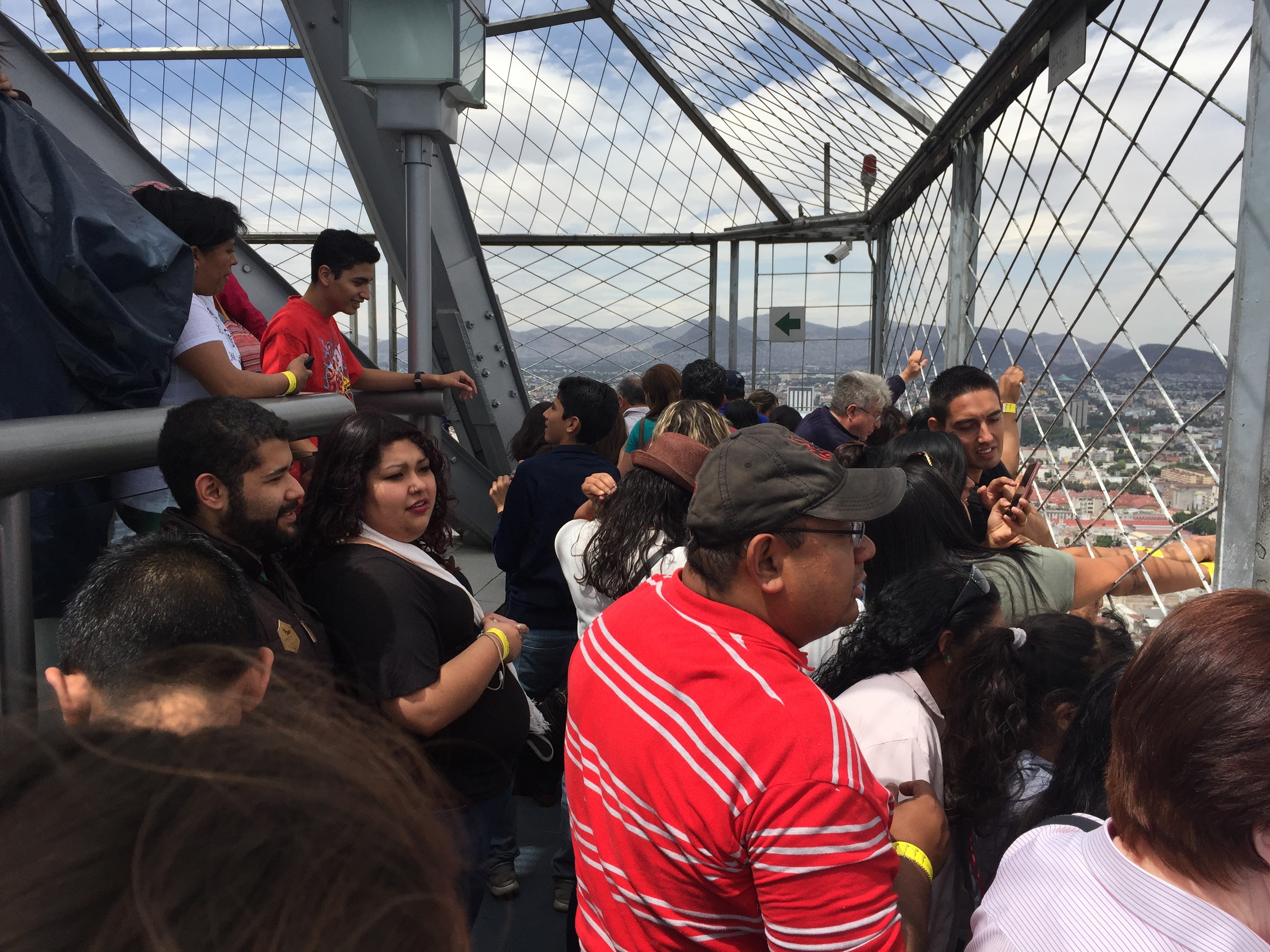 Tourists crowd the top of Torre Latinoamericana in Mexico City.