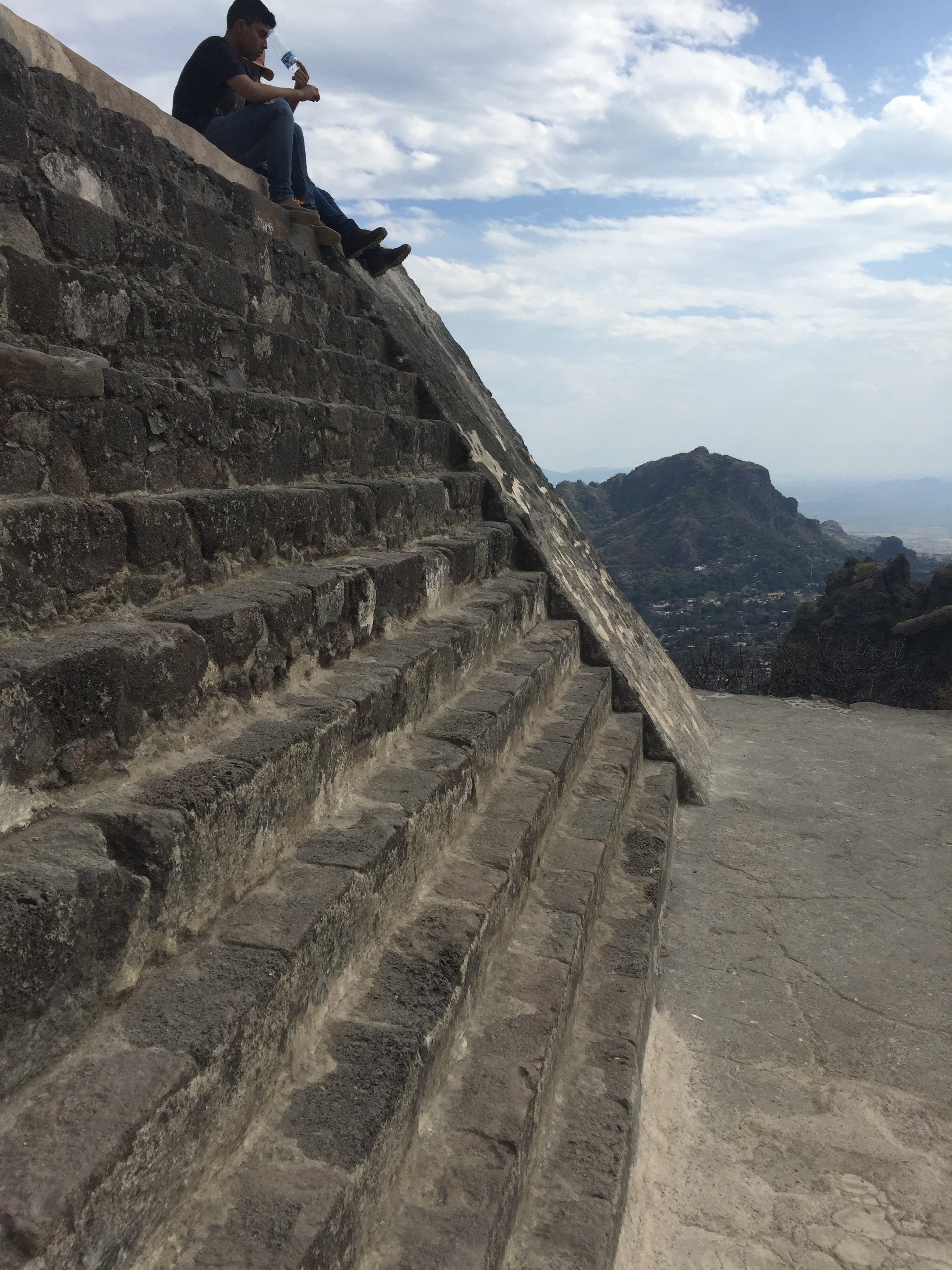 Two Mexicans sit on a pyramid in Tepoztlan.