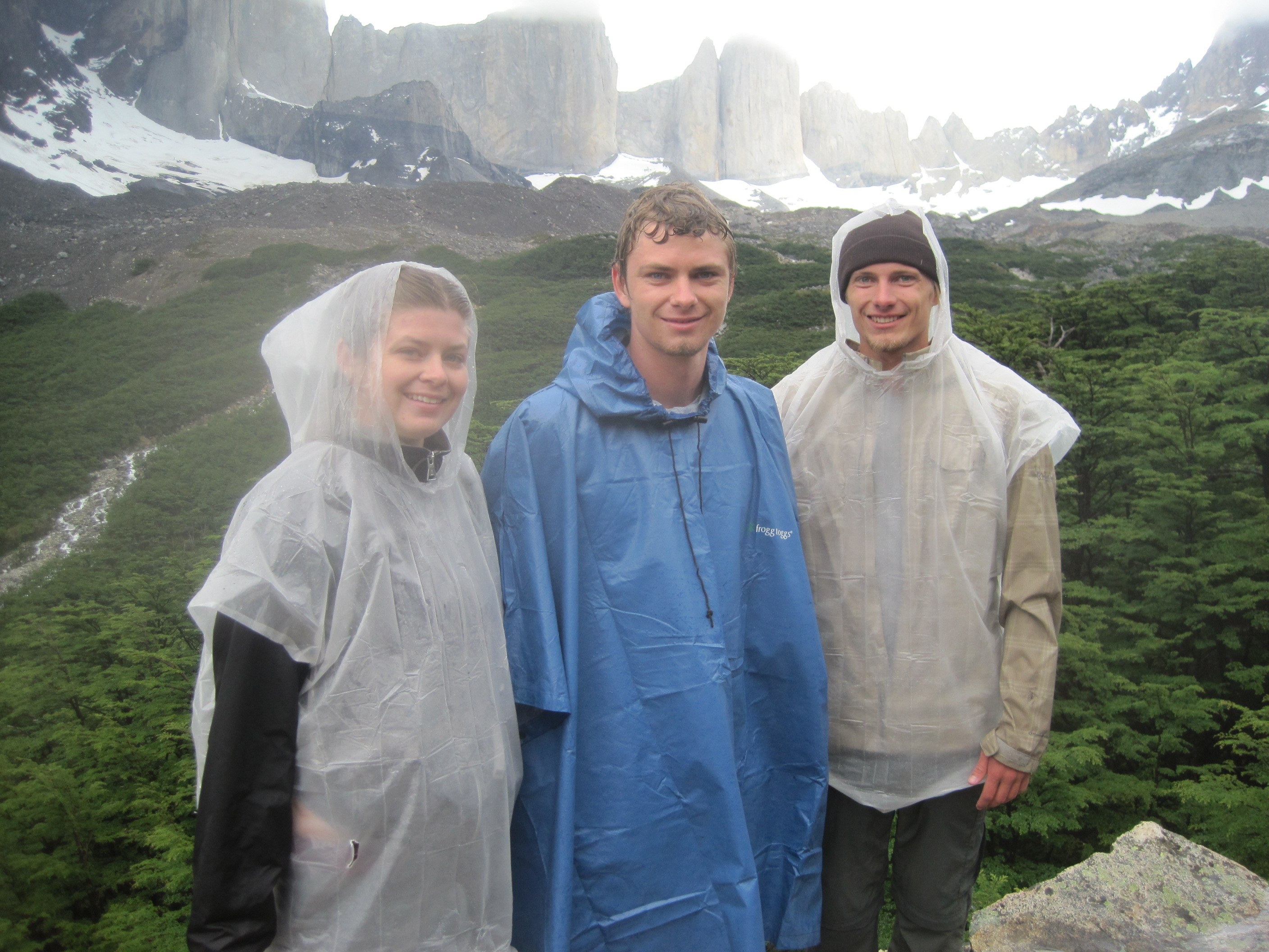 Siblings hiking in the rain in Torres del Paine.
