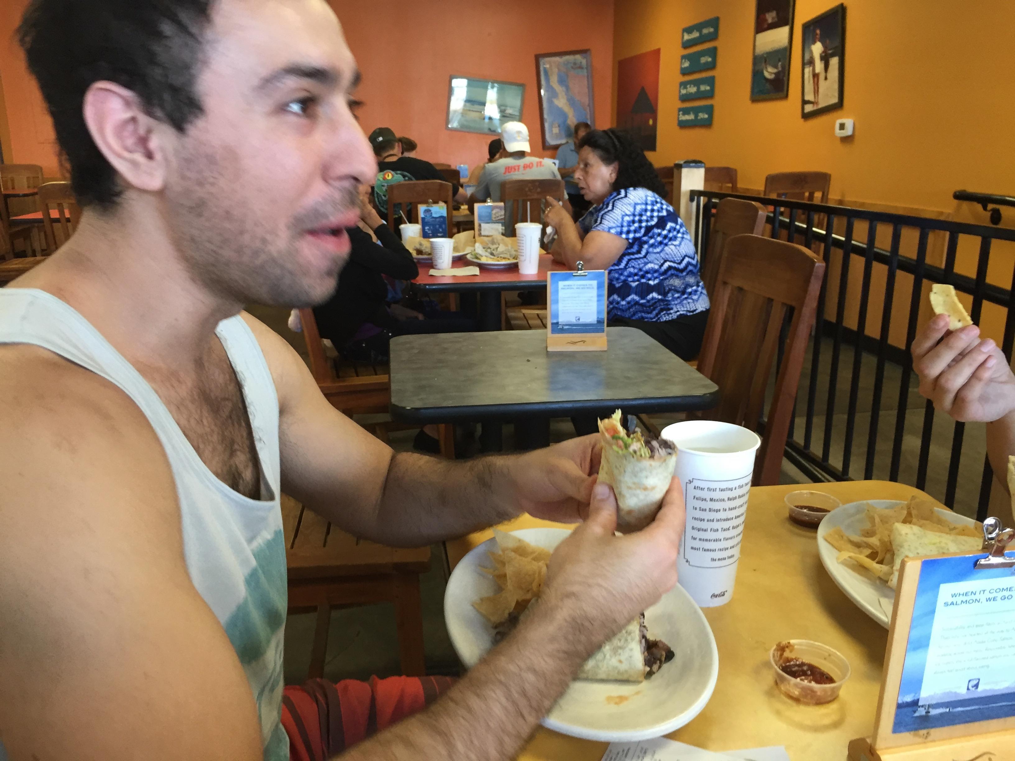 A Chilean eats a burrito at Rubios in San Diego.