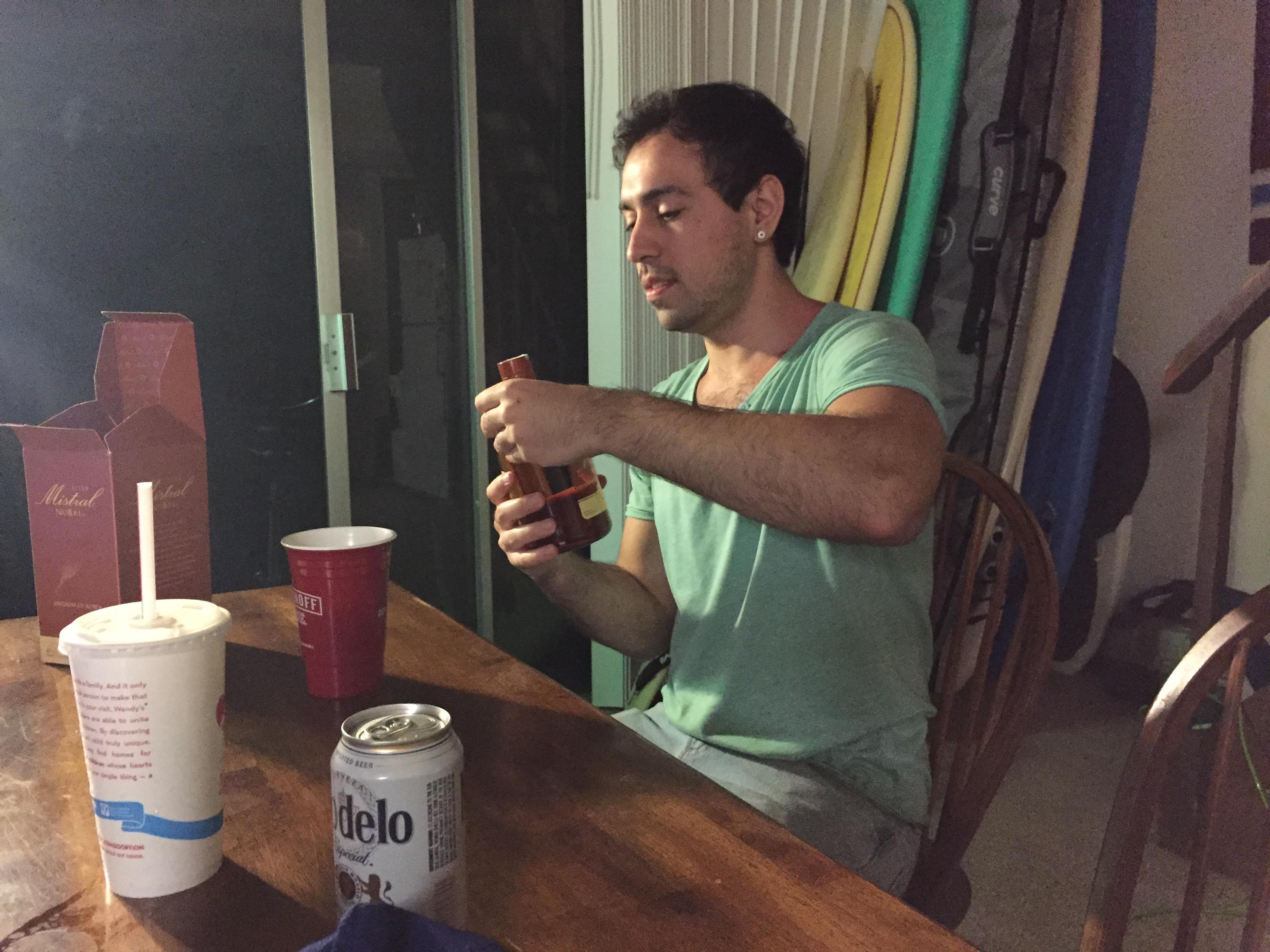 A Chilean opens a bottle of pisco.