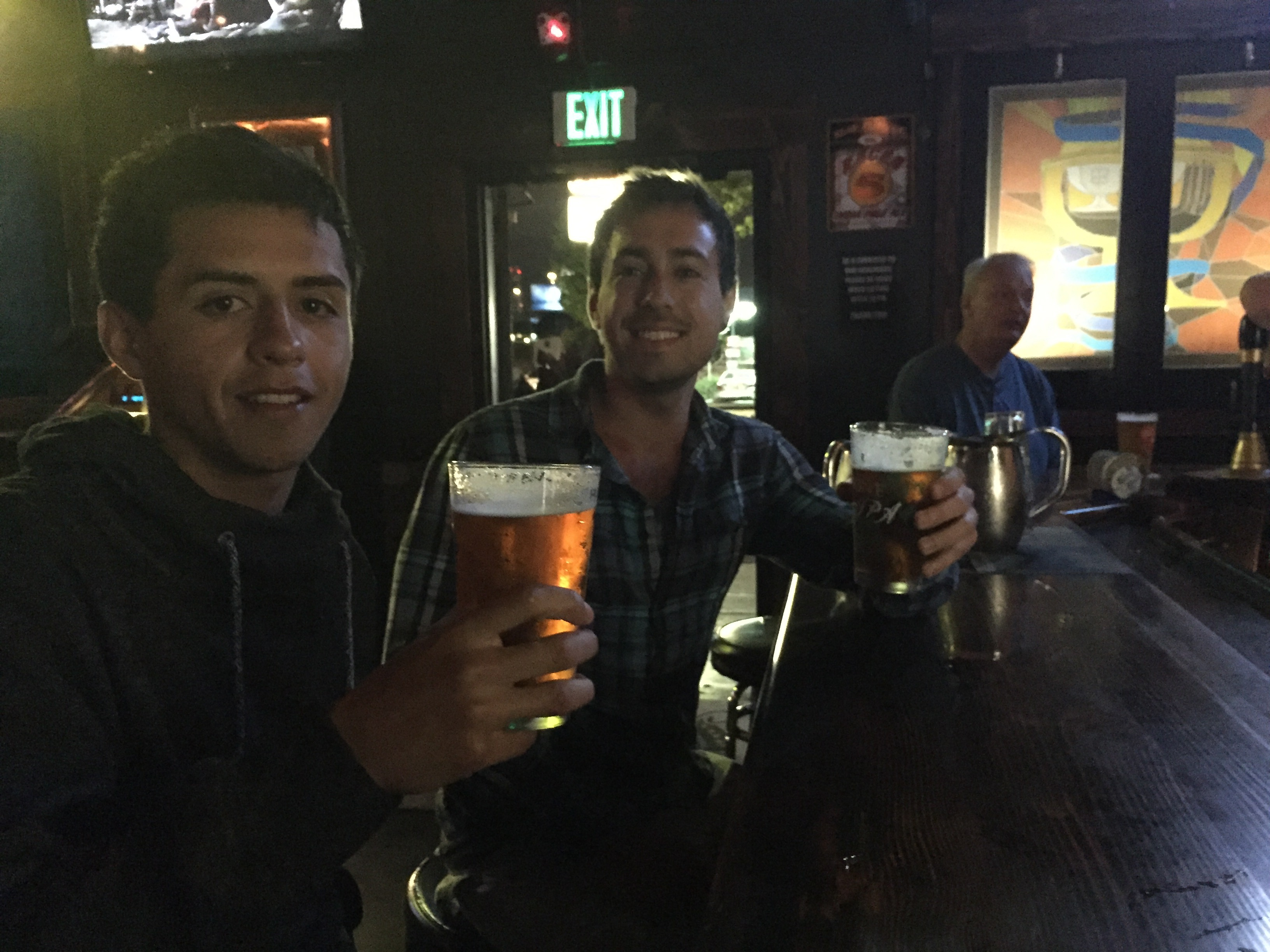 Two Chileans drink beer at Monkey Paw bar in San Diego.