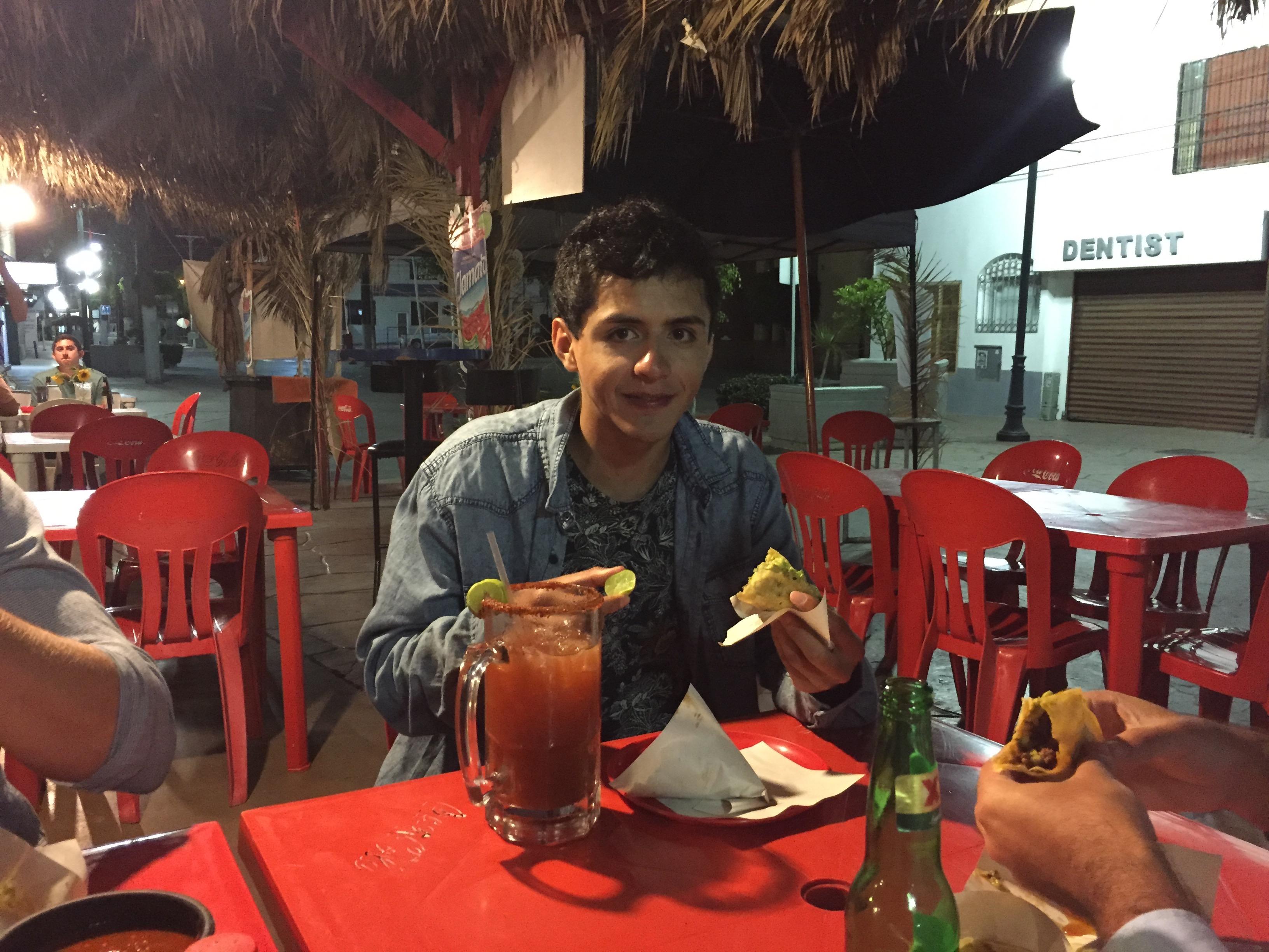 A Chilean eats tacos in Tijuana.