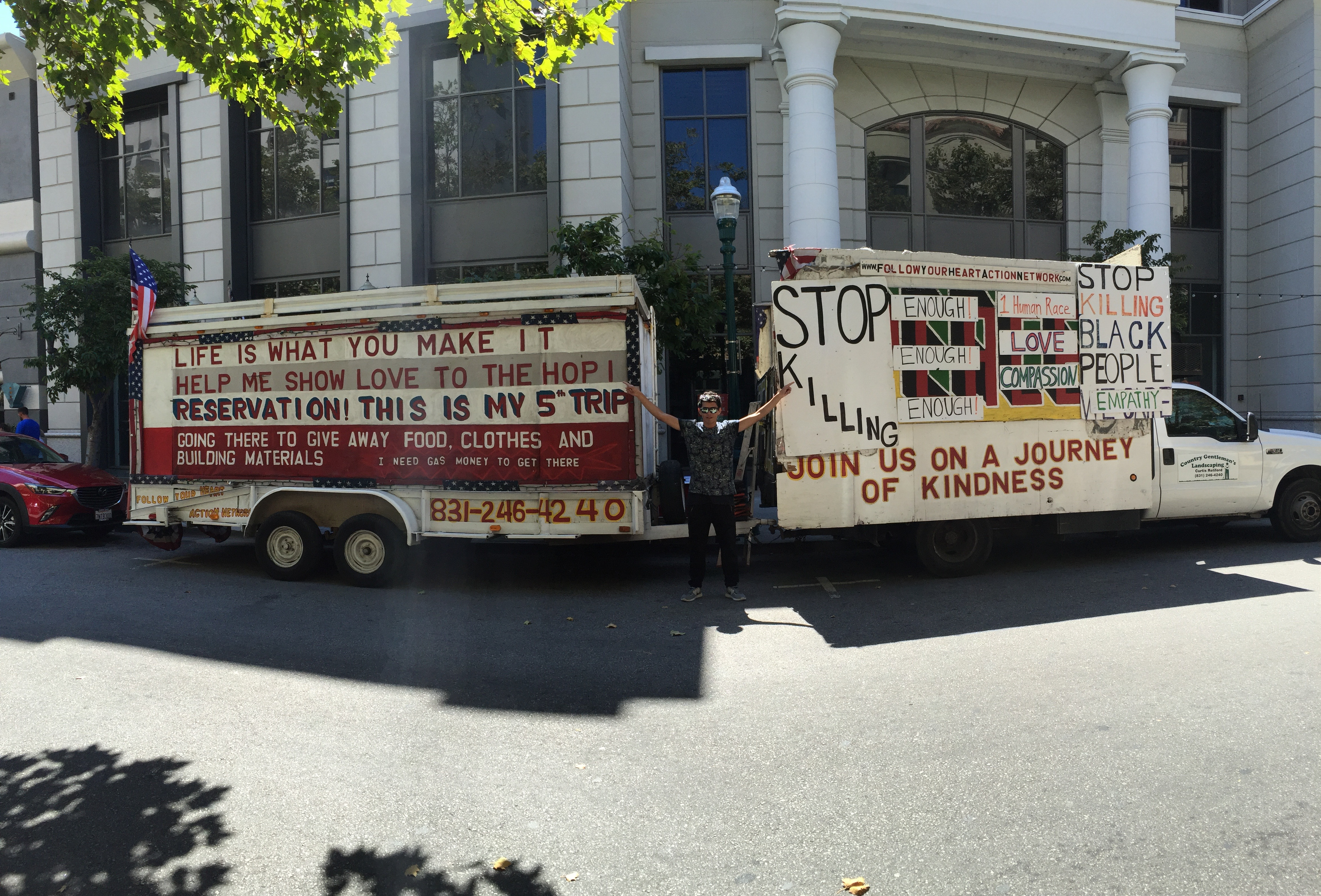 A Chilean in front of a van that promotes peace in Santa Cruz.