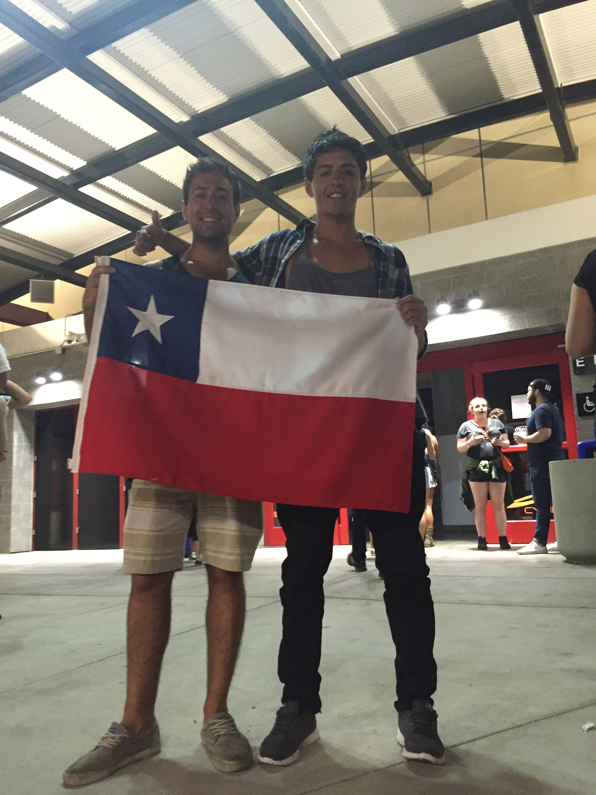 Chileans take a photo with their flag at a concert in San Diego.