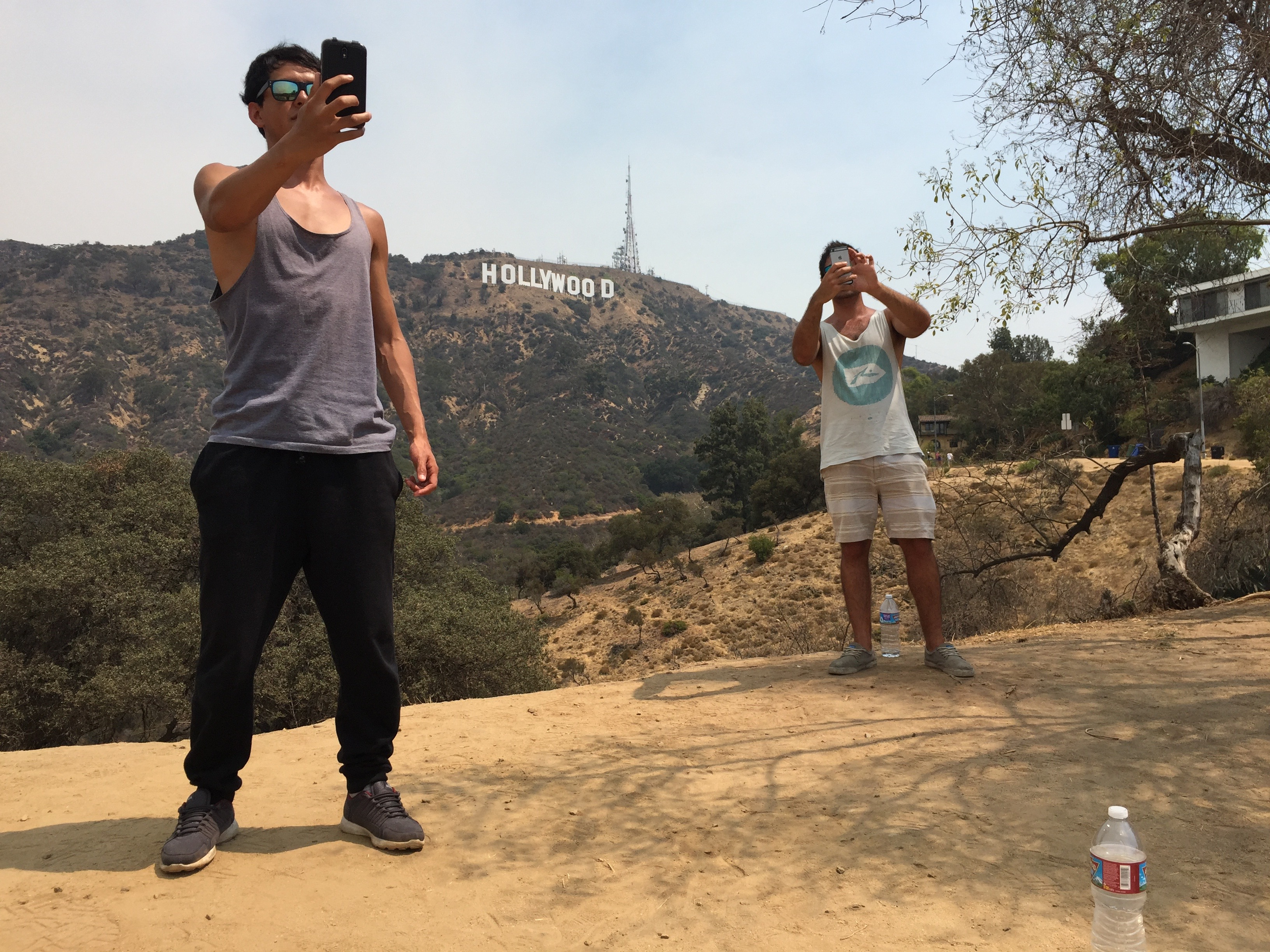 Chileans take selfies in front of the Hollywood sign.