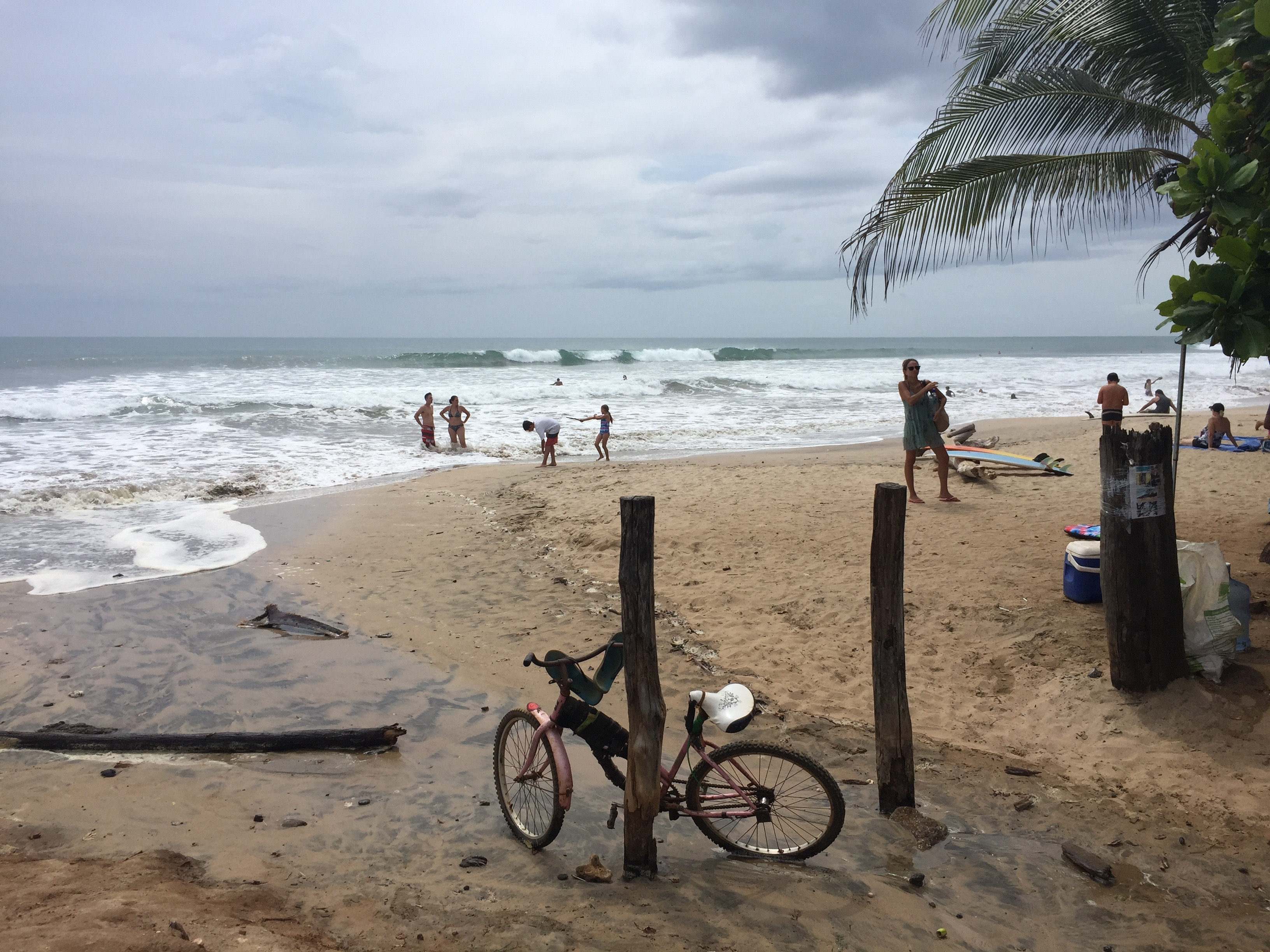 A bike rests on a wood pole at PLaya Avellanas in Costa Rica.