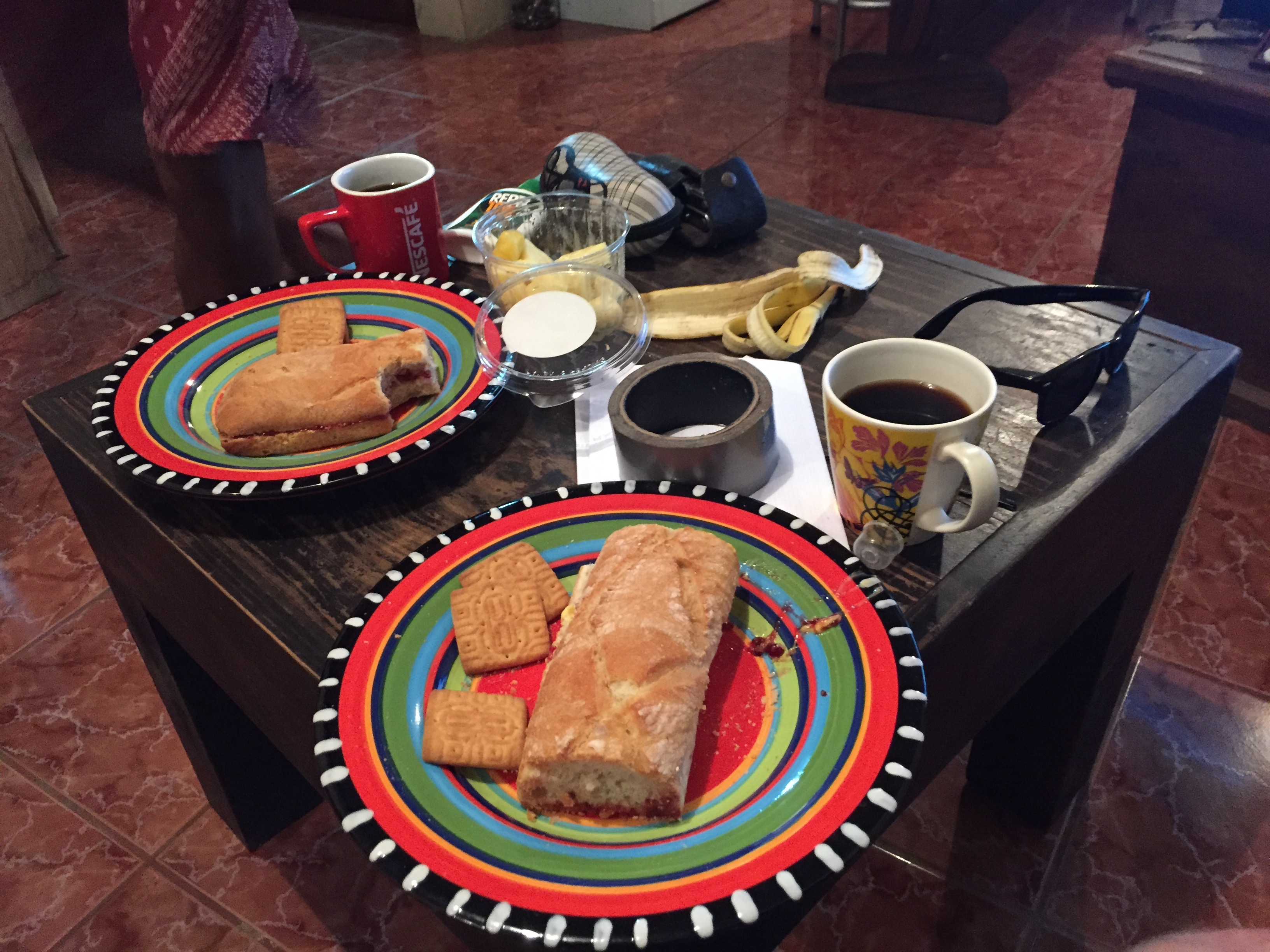 Bread, coffee, and bananas on a table in a living room in Costa Rica.