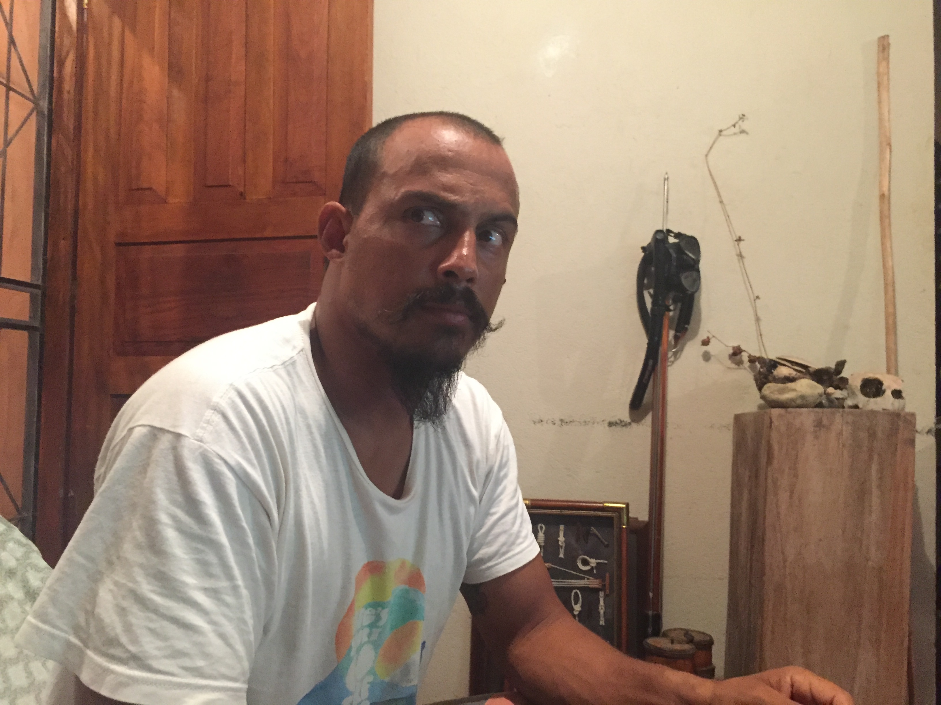 Fabian Sanchez sits on a couch at his house in Tamarindo.