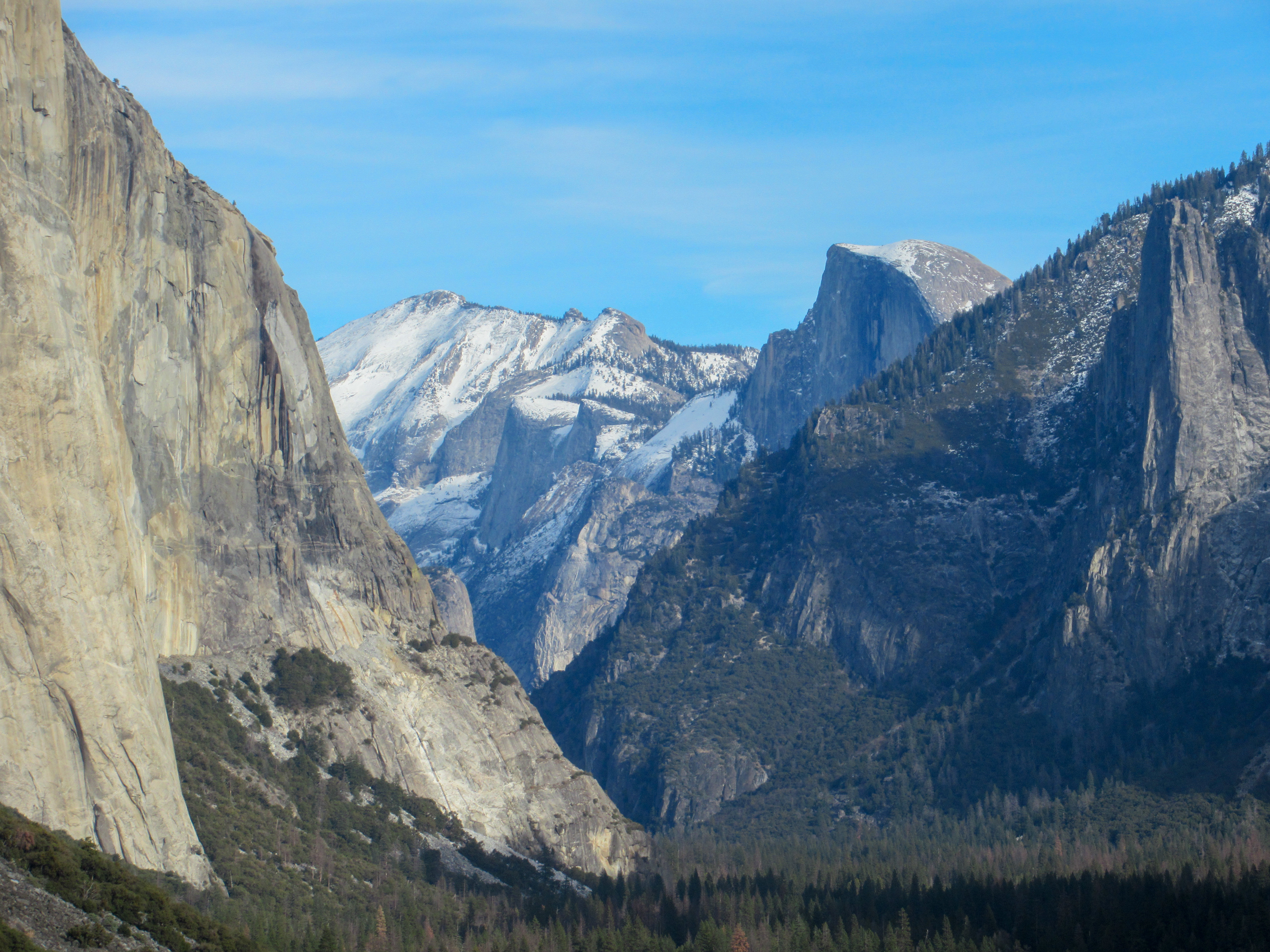 Yosemite Valley with snow blanketing Half Dome and Clouds Rest.