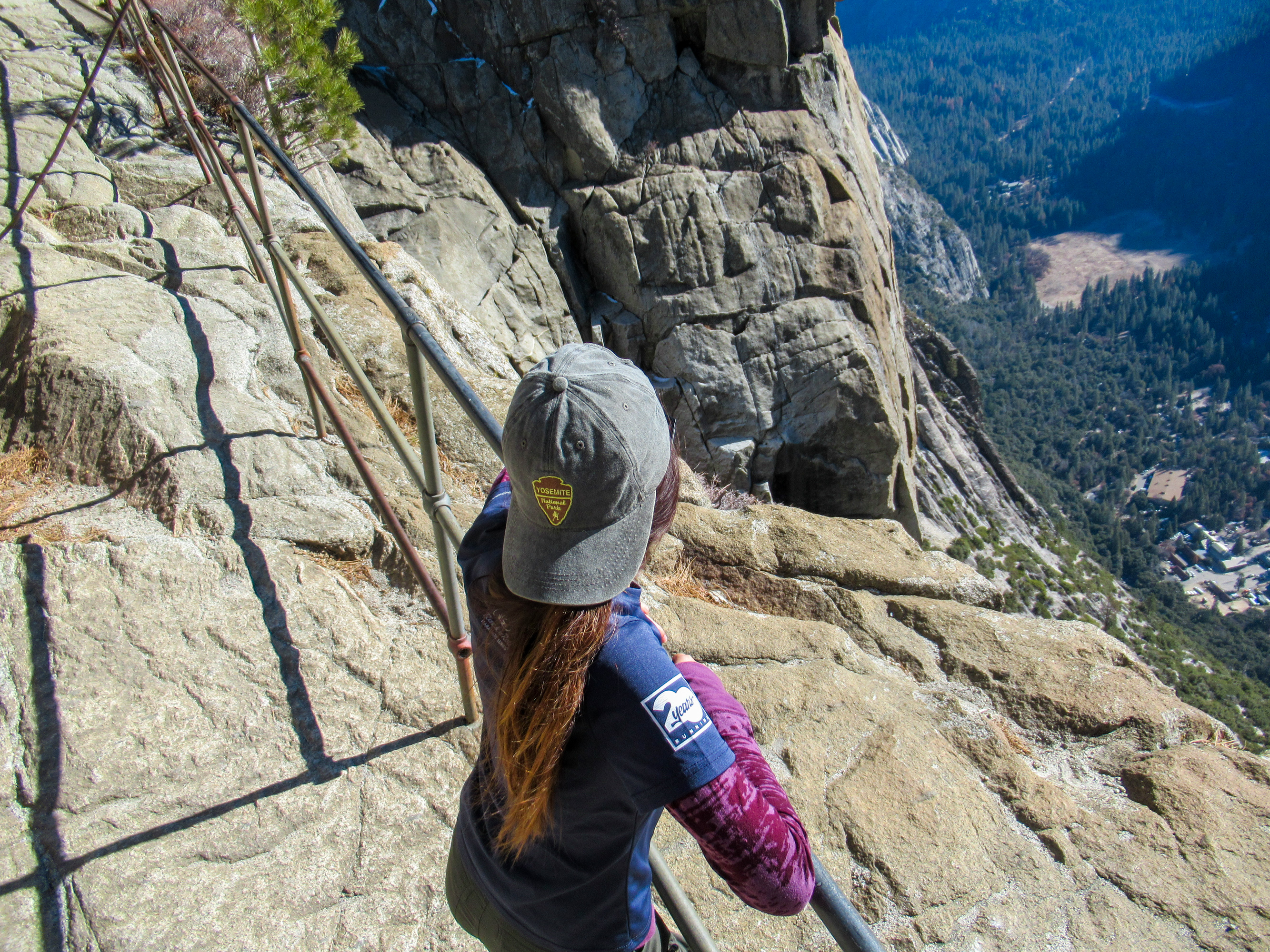 Resting on a railing above Yosemite Valley.