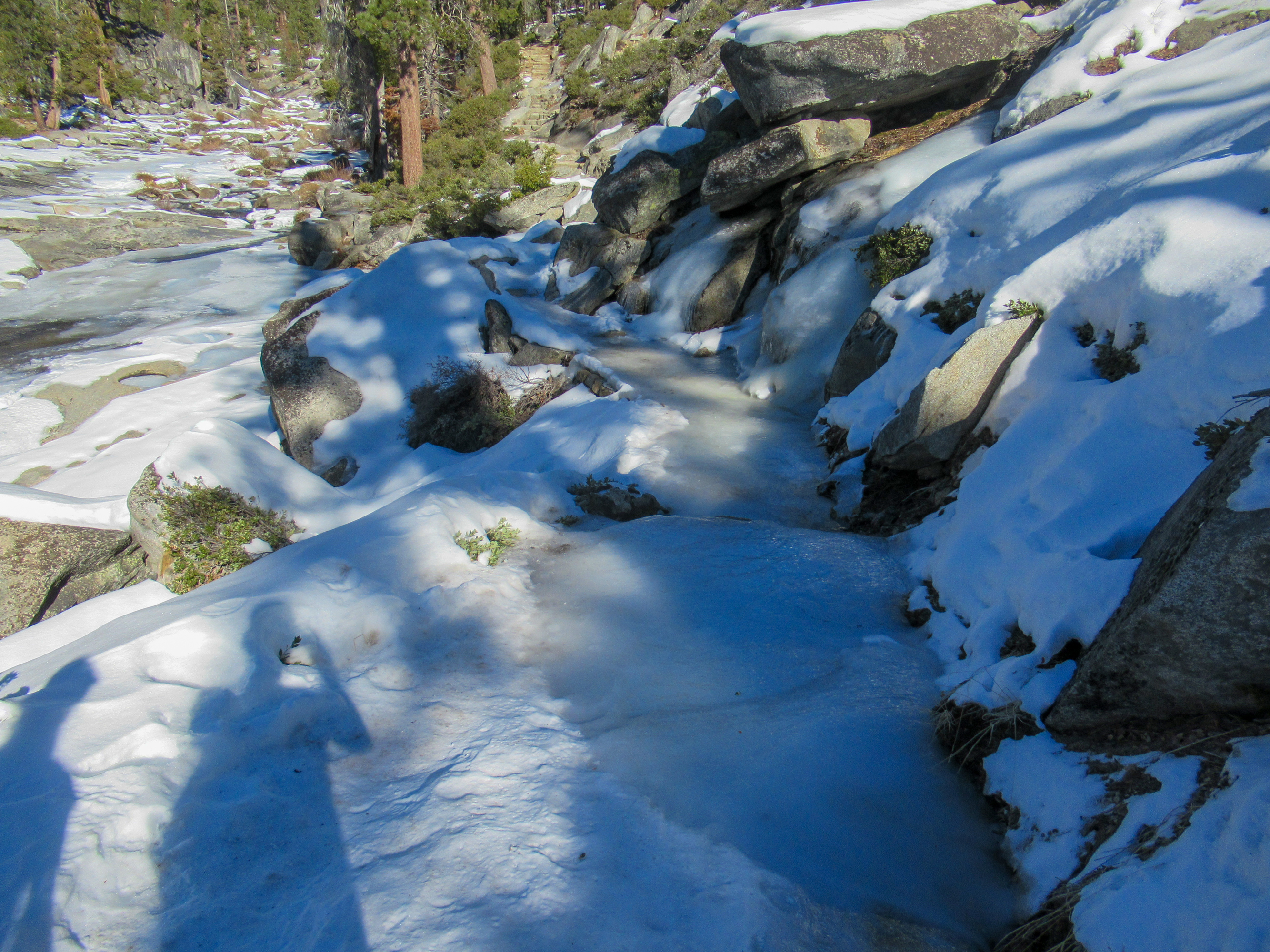Snow and ice cover the trail near Yosemite Falls.