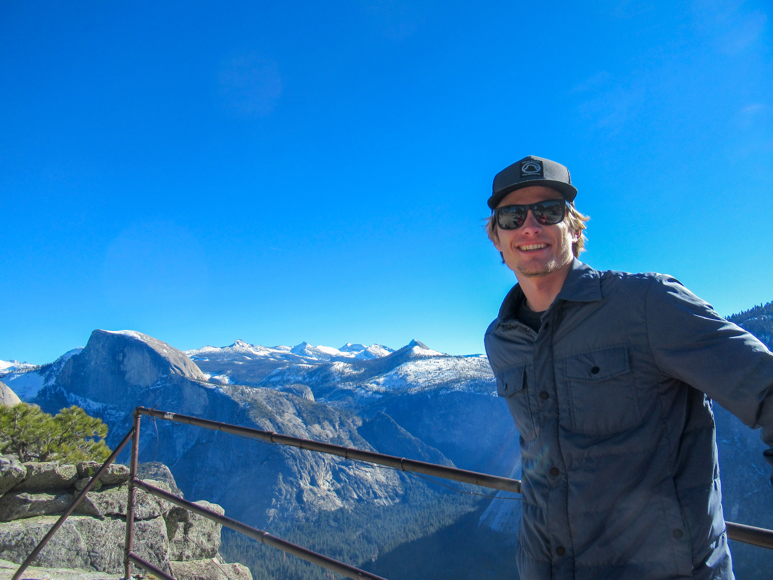 Evan Quarnstrom poses for a photo with Half Dome in the background.
