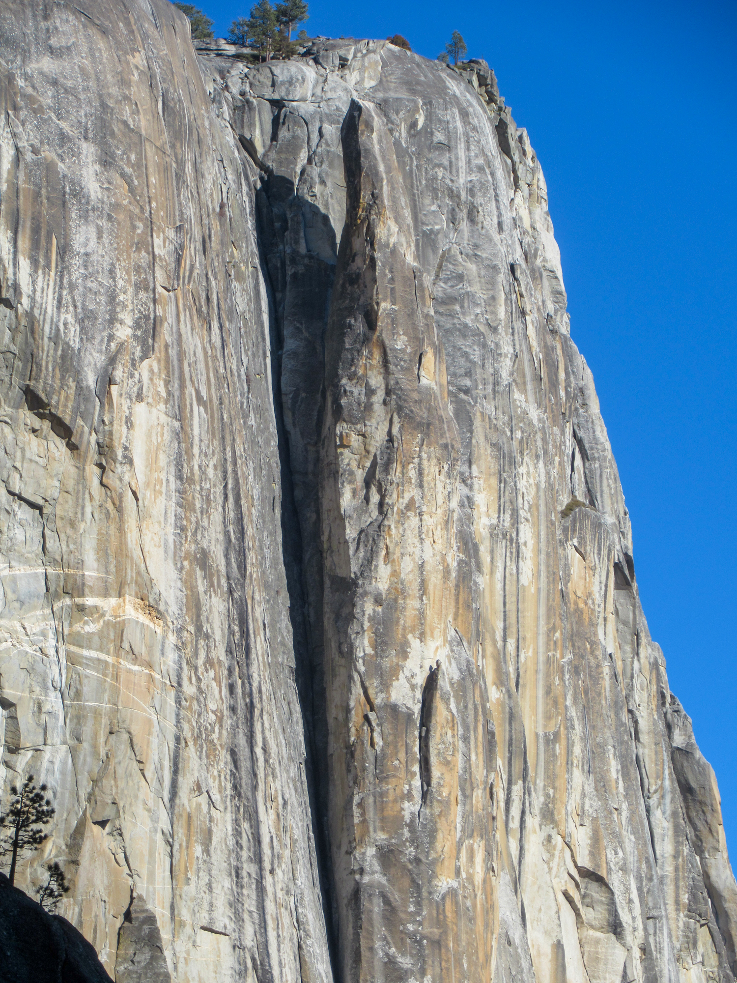 The granite formation of lost arrow spire comes off the wall of the valley.