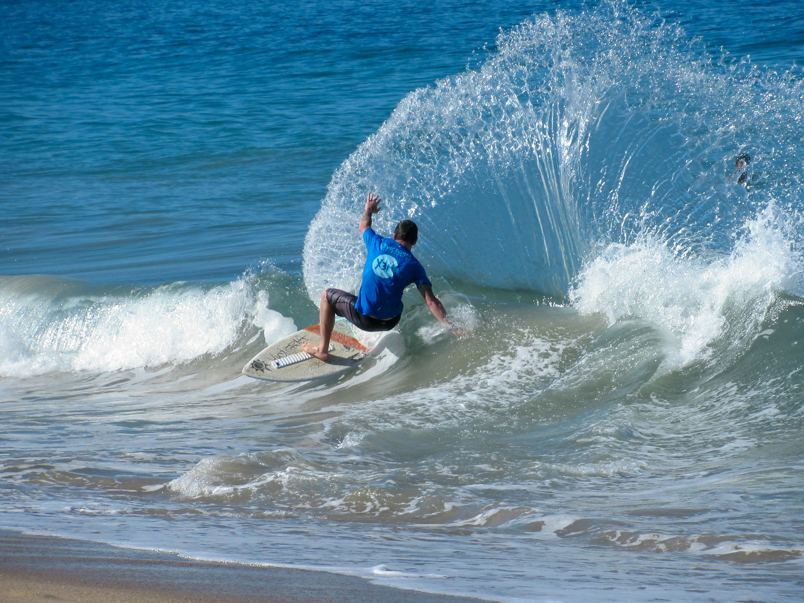 Water sprays flies off a skimboard in Puerto Vallarta.