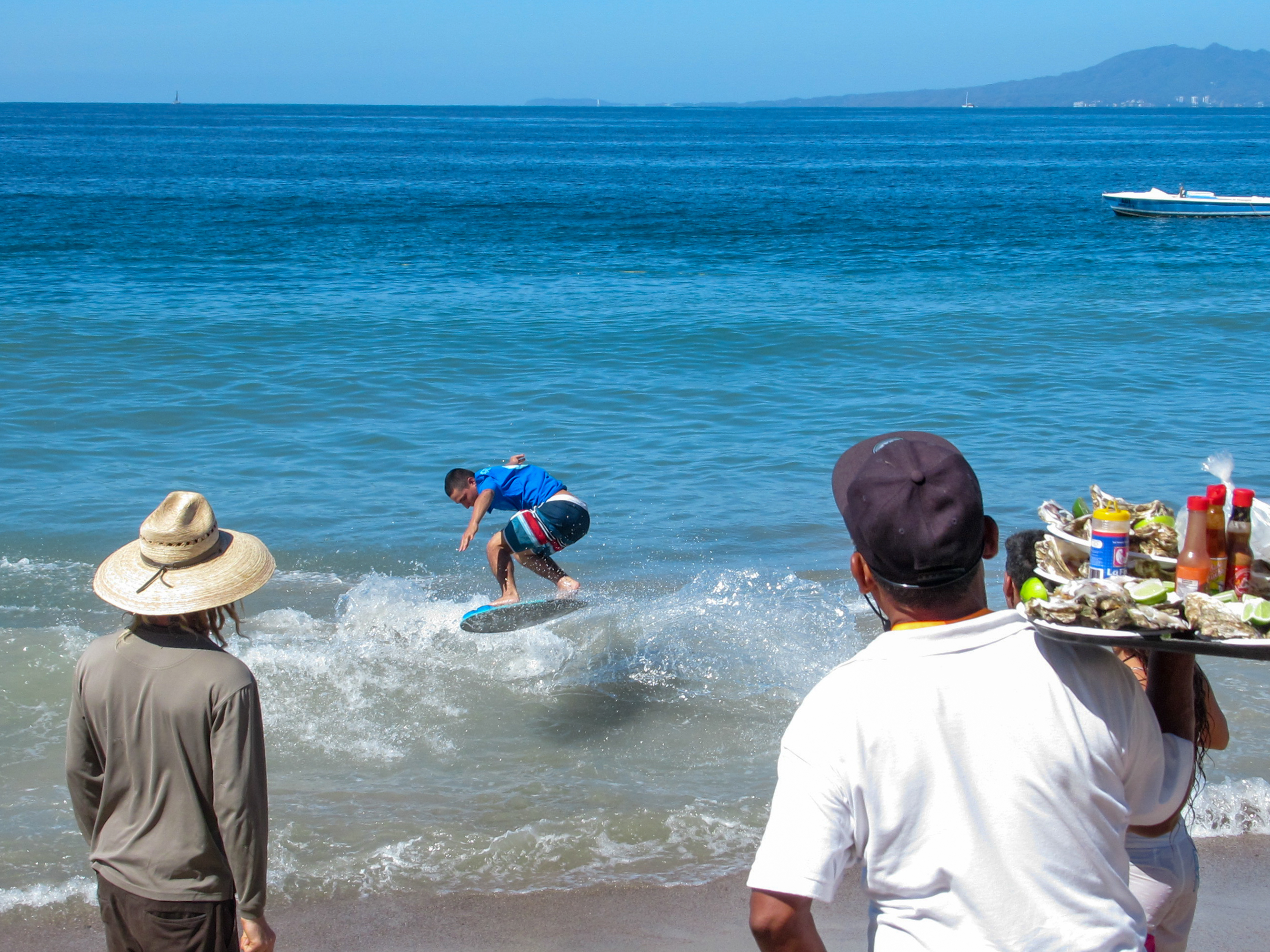 A skimboarder performs an aerial maneuver in Puerto Vallarta.