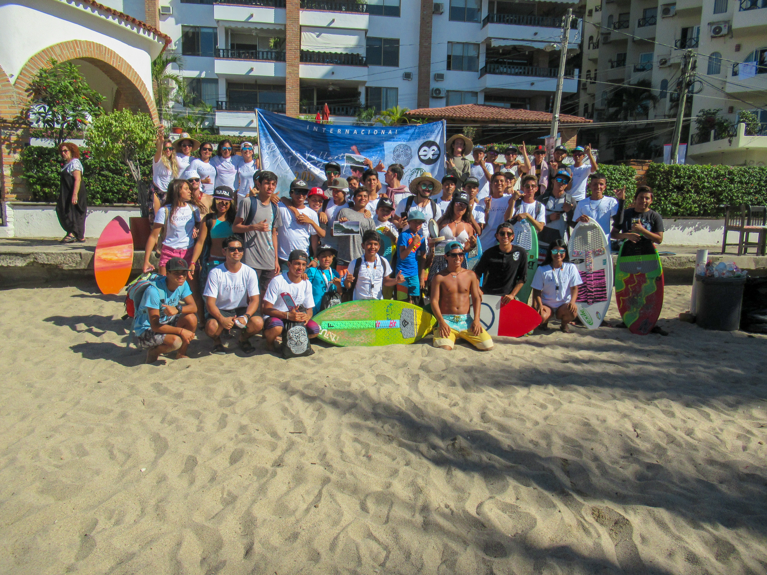 Skimboarders from all around Mexico and the USA take a group photo.