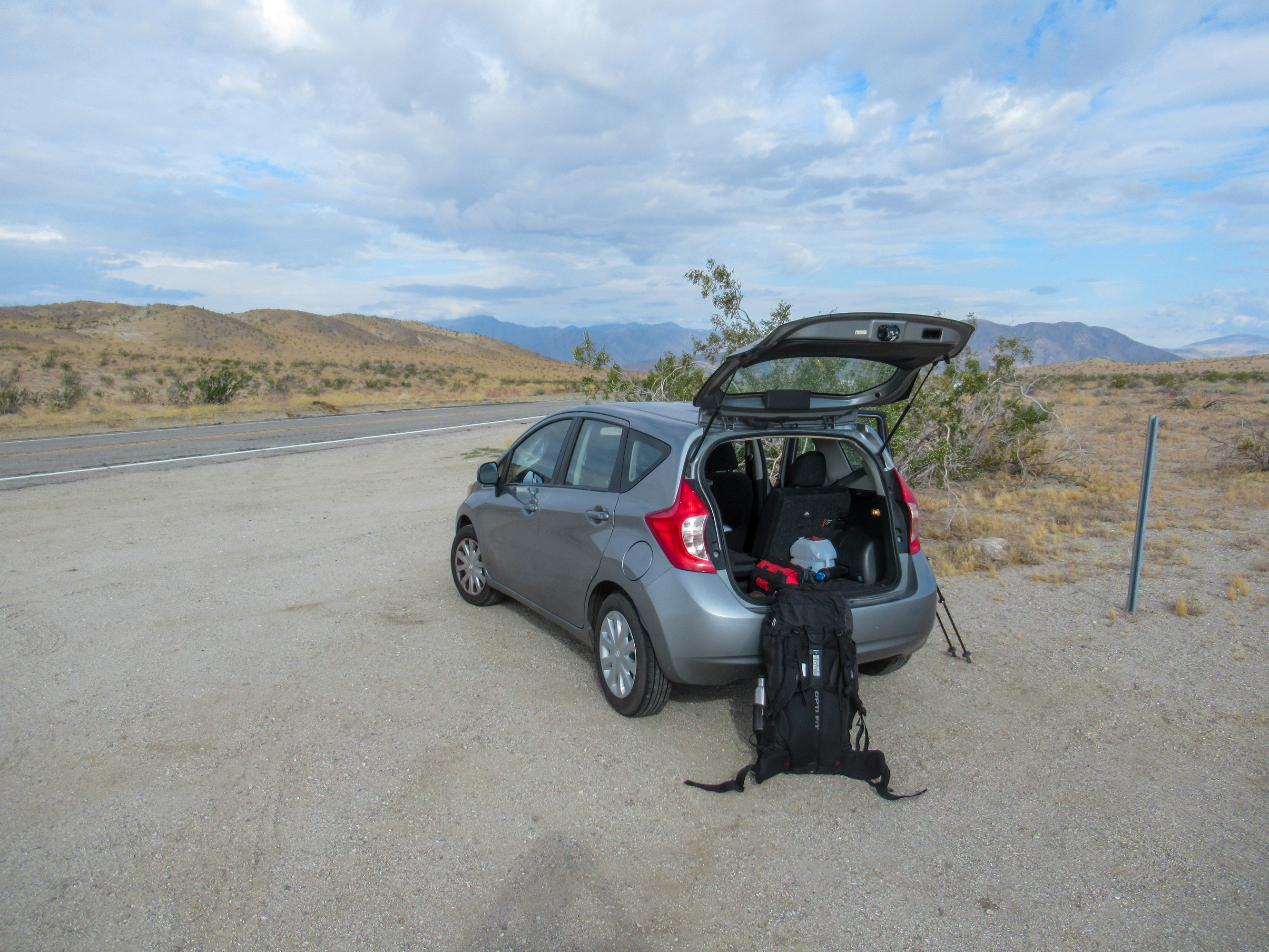 My Nissan Versa parked at the trailhead for Rabbit Peak in the Anza Borrego desert.
