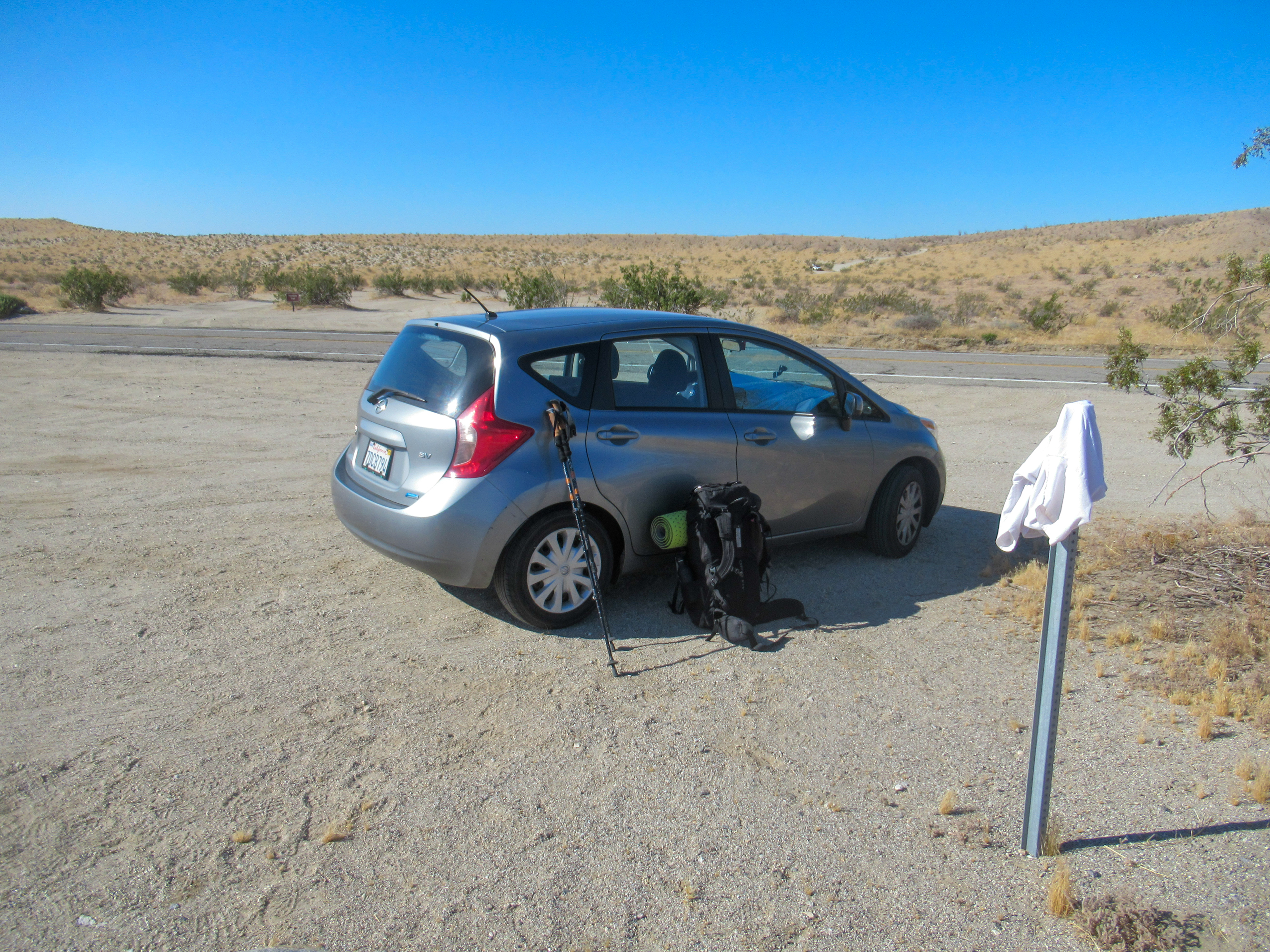 Nissan Versa parked at the Villager Peak trailhead.