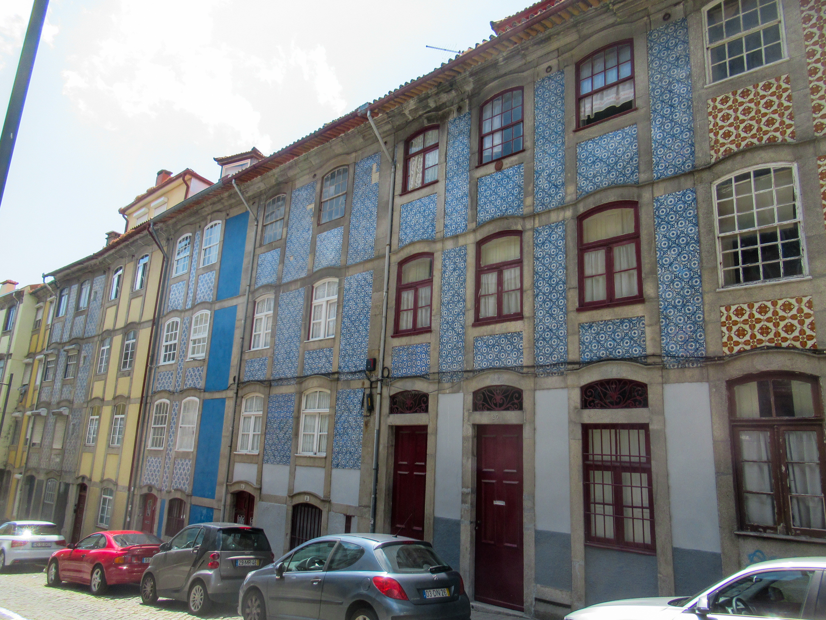 Tiled building in the narrow streets of Porto, Portugal.