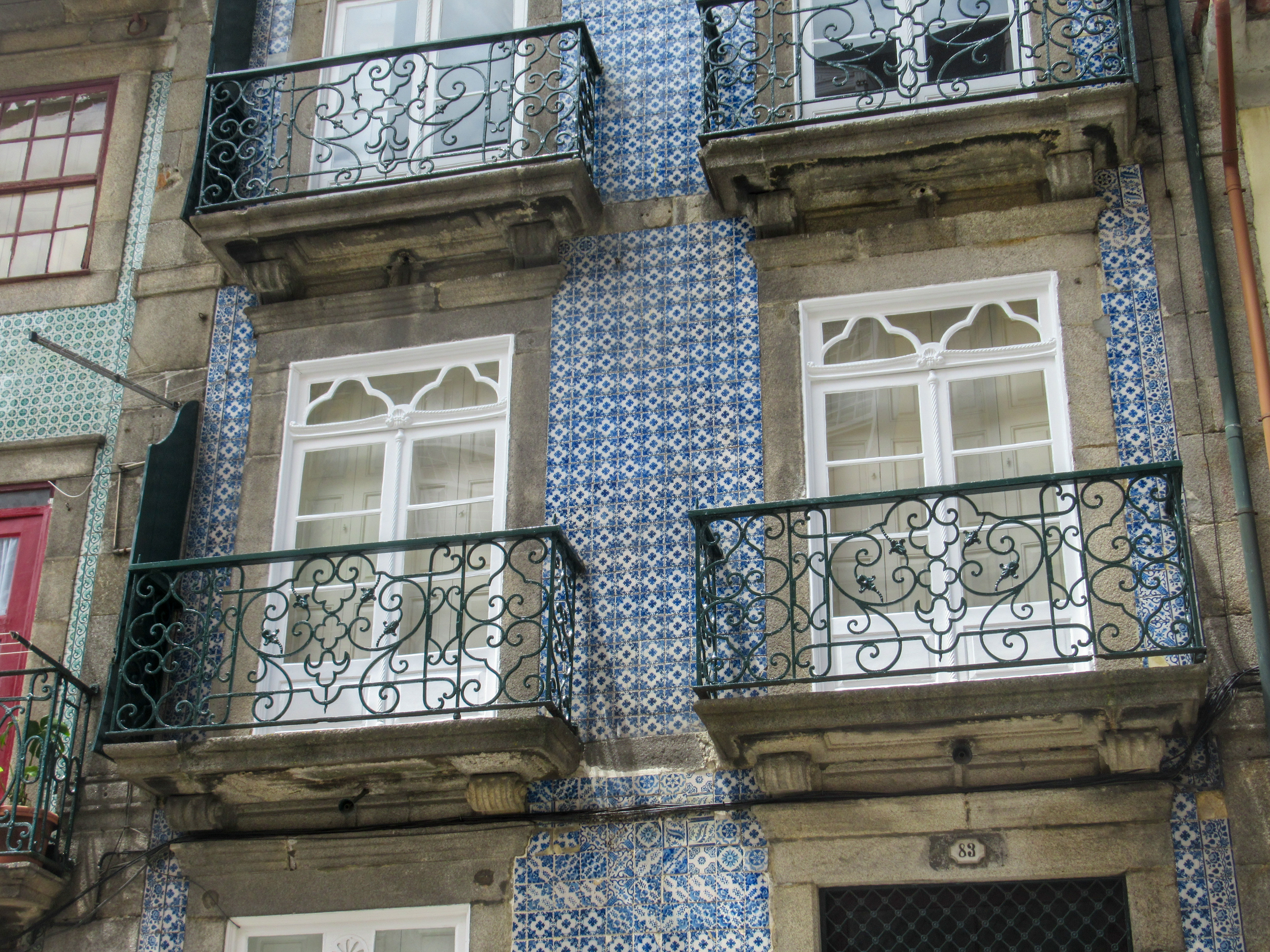 Blue tiles on the side of a building in Porto, Portugal.