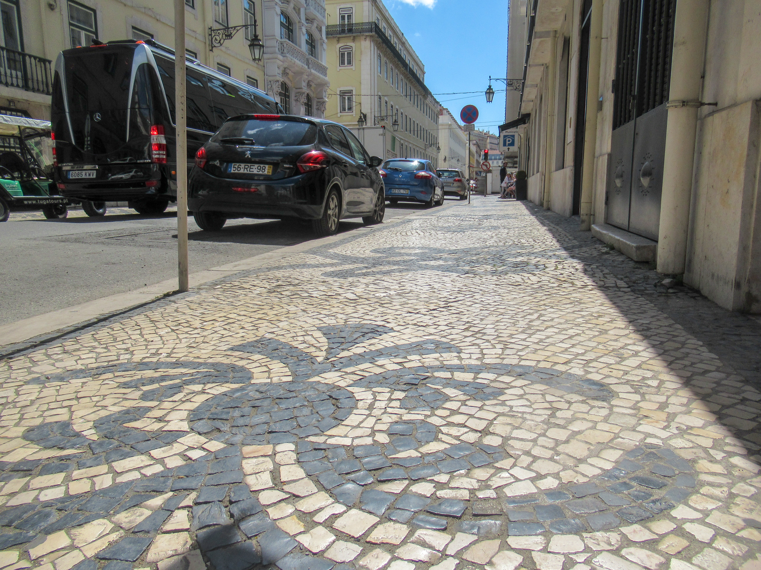 Tile Mosaic designs on the sidewalk in Lisbon, Portugal.