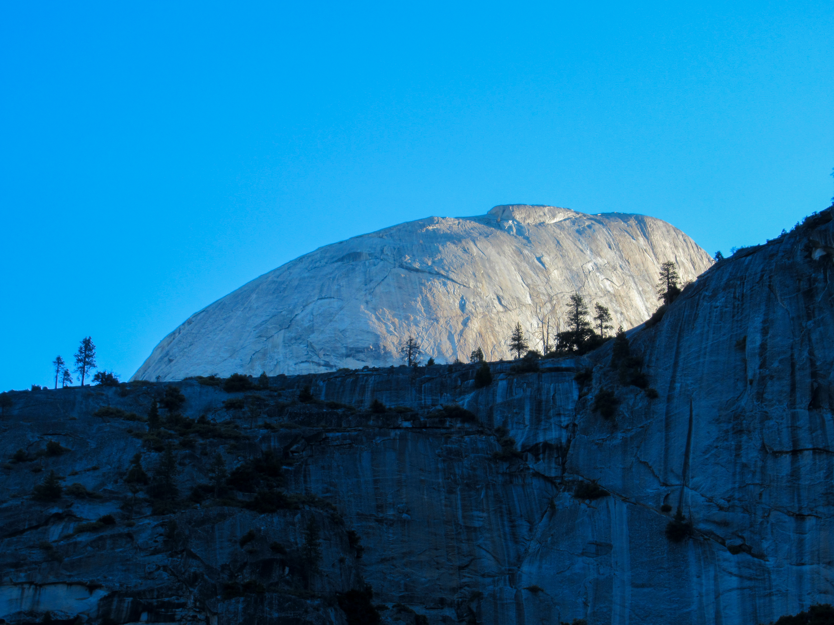 Sunrise shines on the backside of Half Dome.