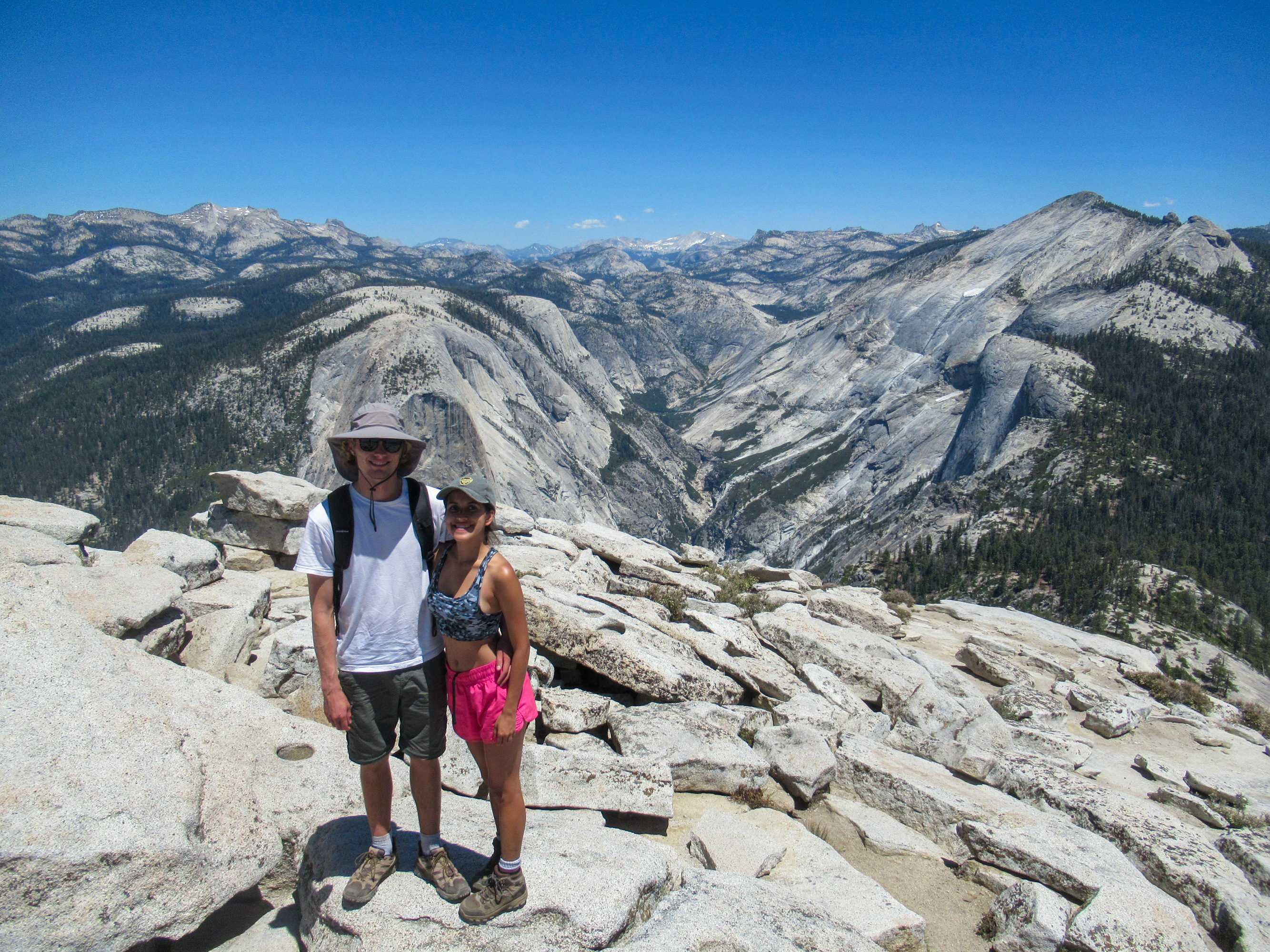 Evan Quarnstrom and Madison Snively take in the views atop Half Dome.