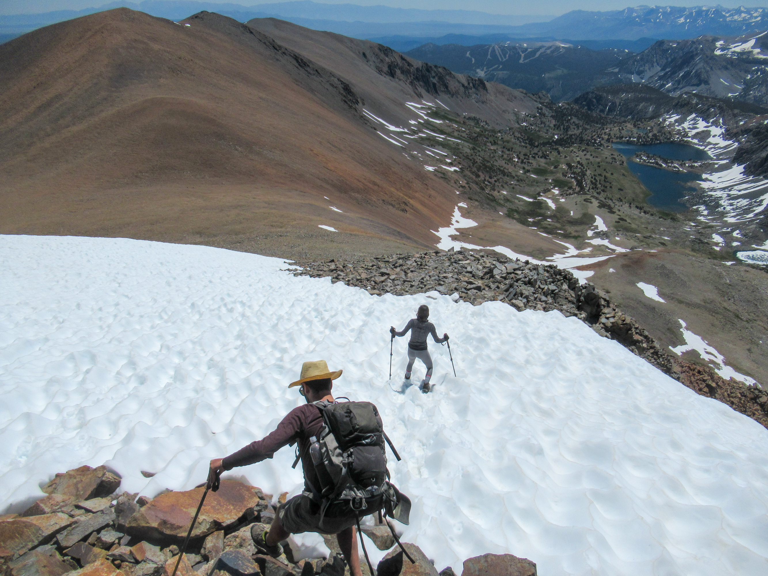Crossing a snow field on top of Koip Peak.