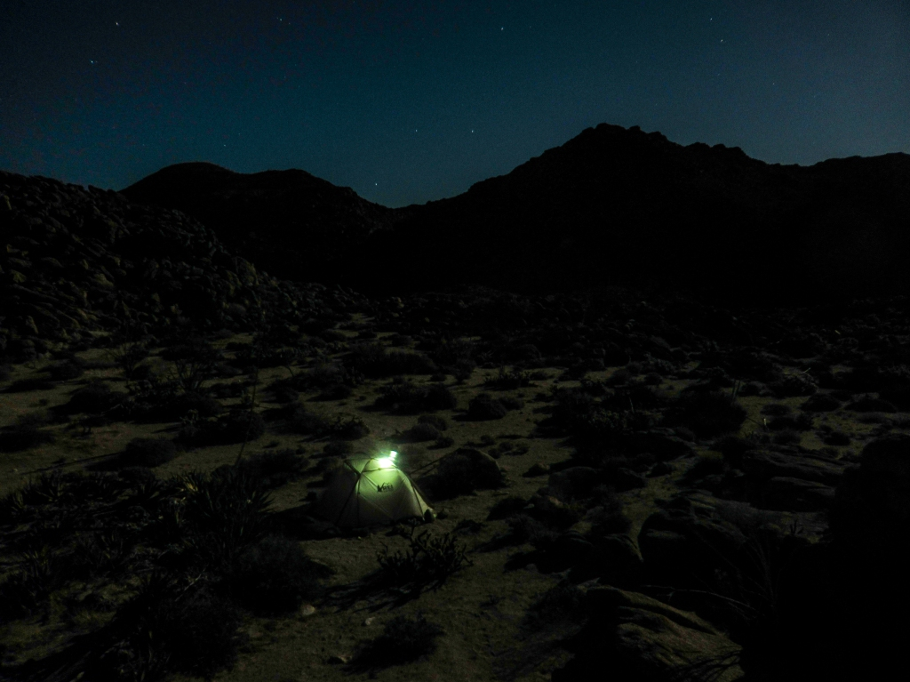Nighttime shot of camping in the desert under a full moon.