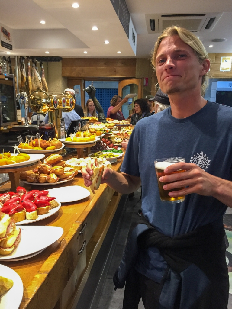 Evan Quarnstrom drinking a beer at a bar in San Sebastian, Spain.