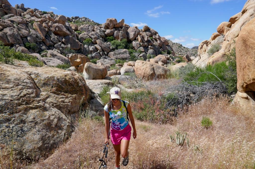 Madison Snively hiking over boulders to Jacumba Peak.