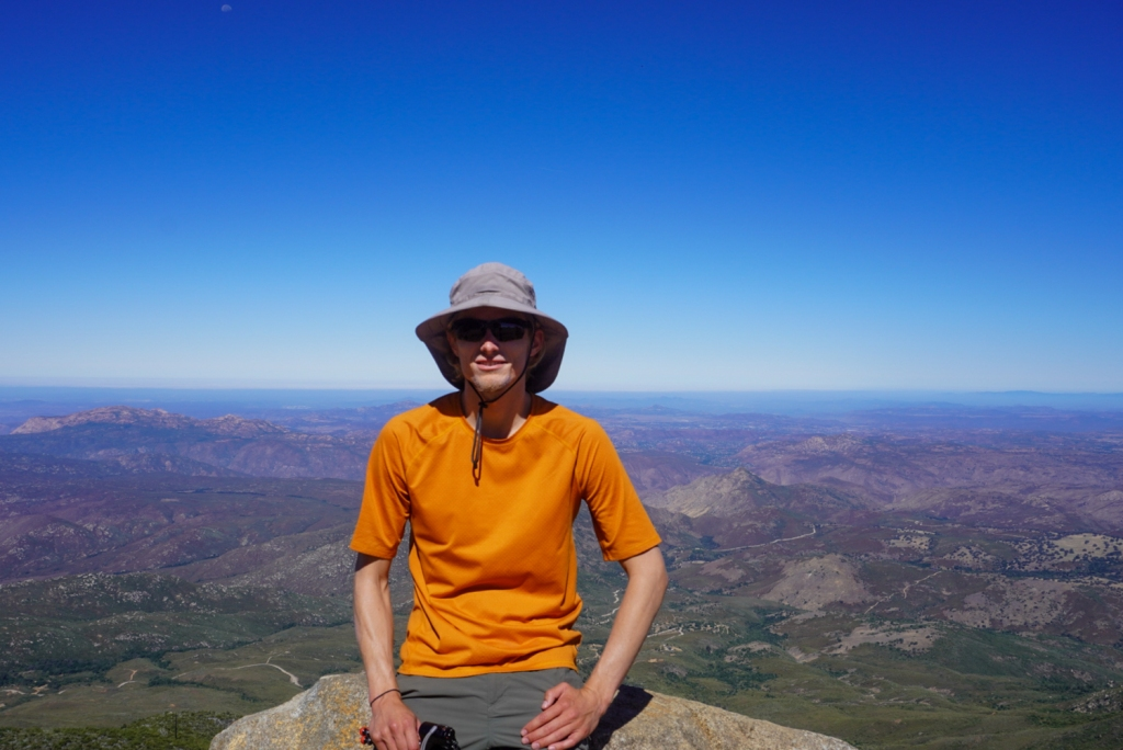 Evan Quarnstrom poses for a photo on top of Cuyamaca Peak.