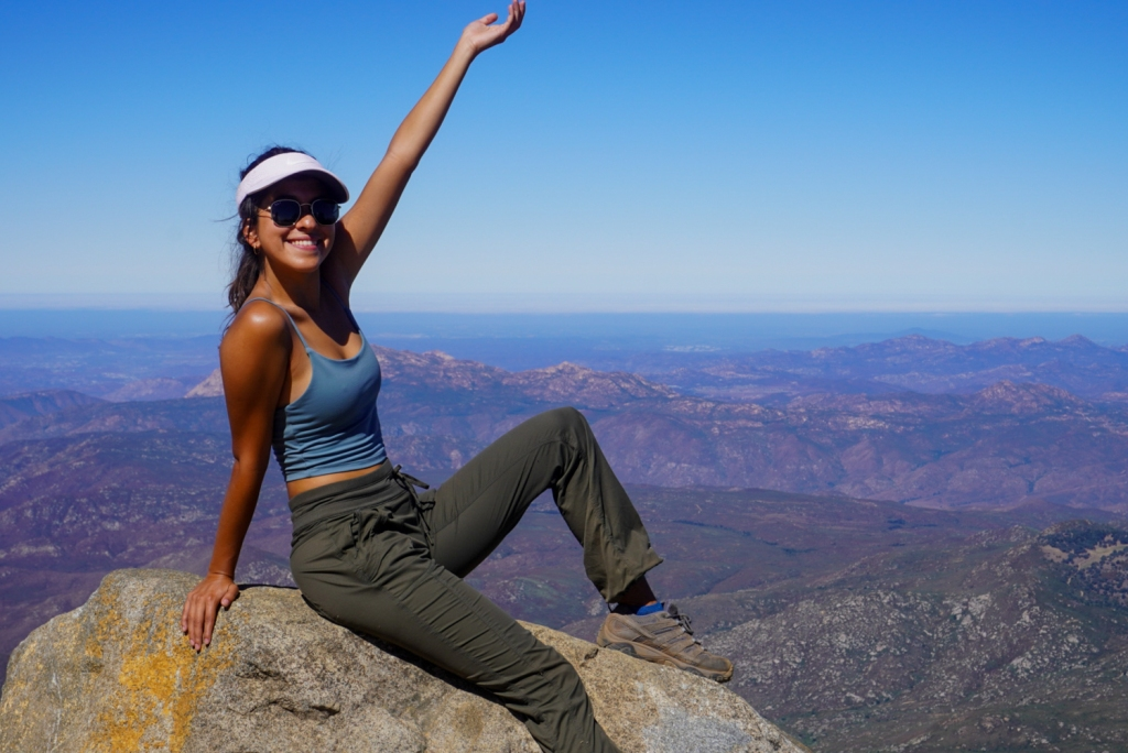 Madison Snively poses for a photo on top of Cuyamaca Peak.