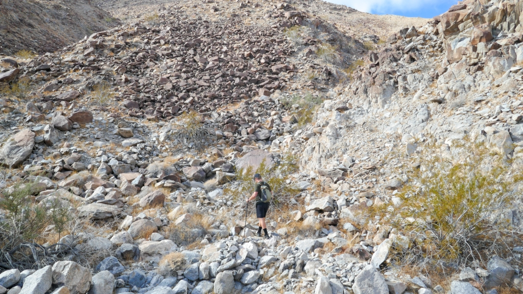 Nate Straus hikes on loose rocks in the Fish Creek Mountains.