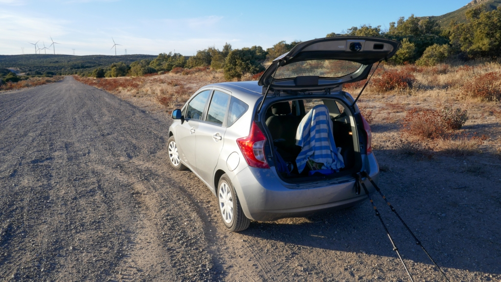 A Nissan Versa is parked on a dirt road in McCain Valley.