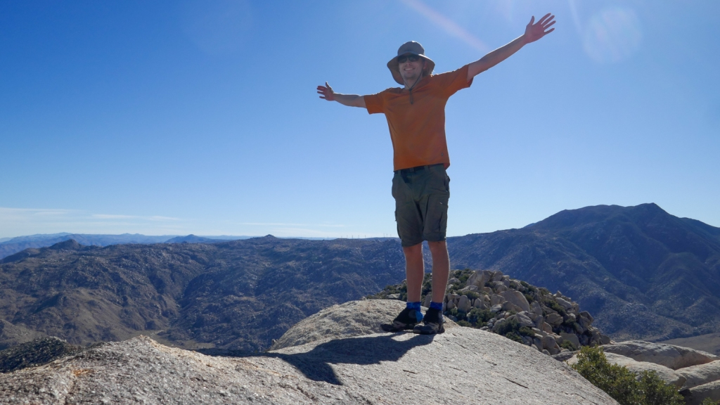 Evan Quarnstrom poses for a photo on top of Red Top Mountain.