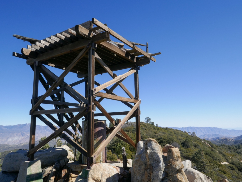 A wooden lookout tower on the top of Hot Springs Mountain.