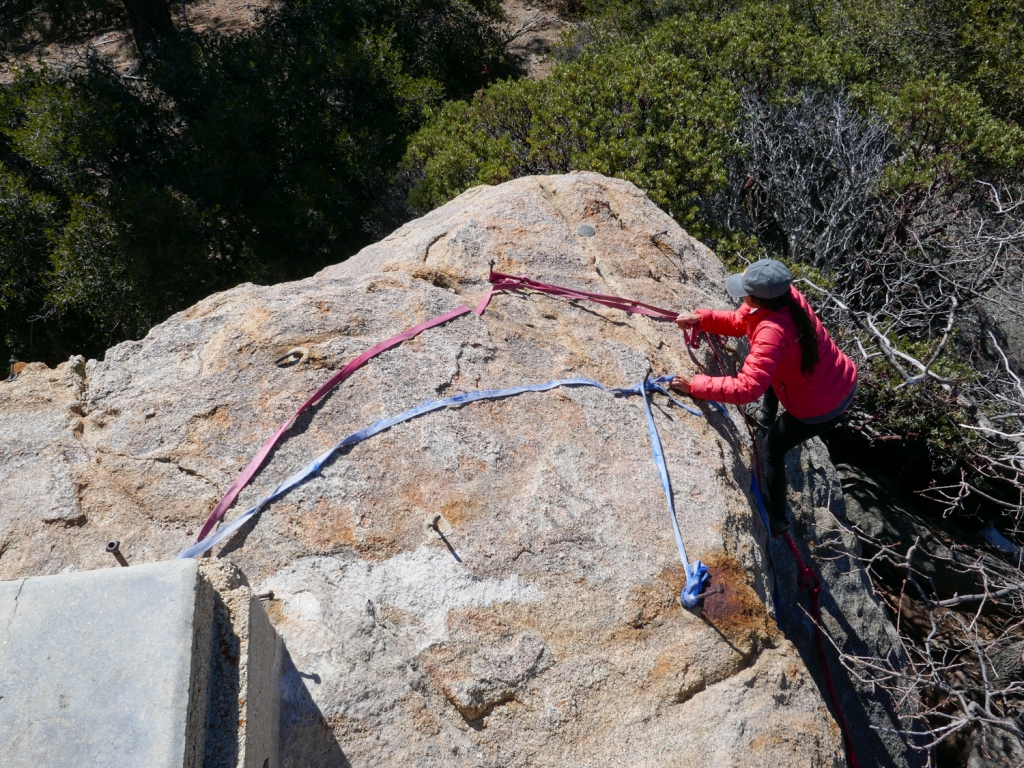 Madison Snively climbs a rope to the top of Hot Springs Mountain.