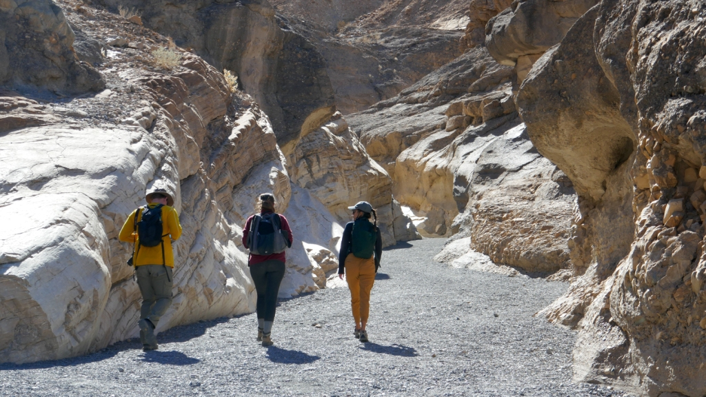 Hikers walk on. theMosaic Canyon Trail in Death Valley National Park.