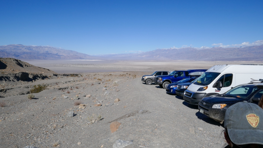A parking lot of cars at the trailhead for Mosaic Canyon in Death Valley National Park.