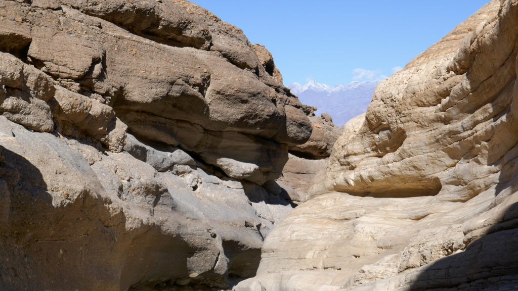Hiking in a slot of Mosaic Canyon of Death Valley National Park.