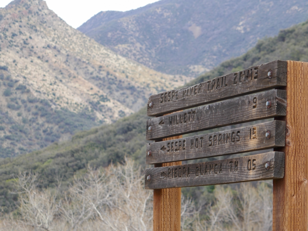 The trail sign with destinations in Los Padres National Forest.