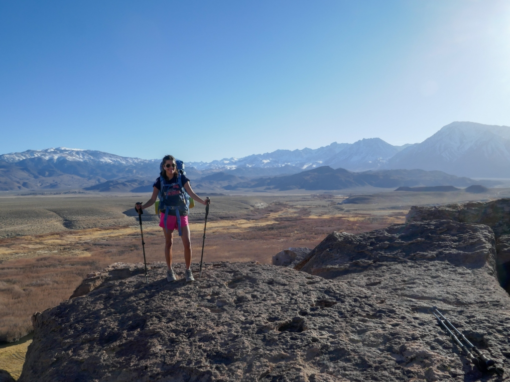 Madison Snively stands atop the volcanic tablelands of Bishop, California.