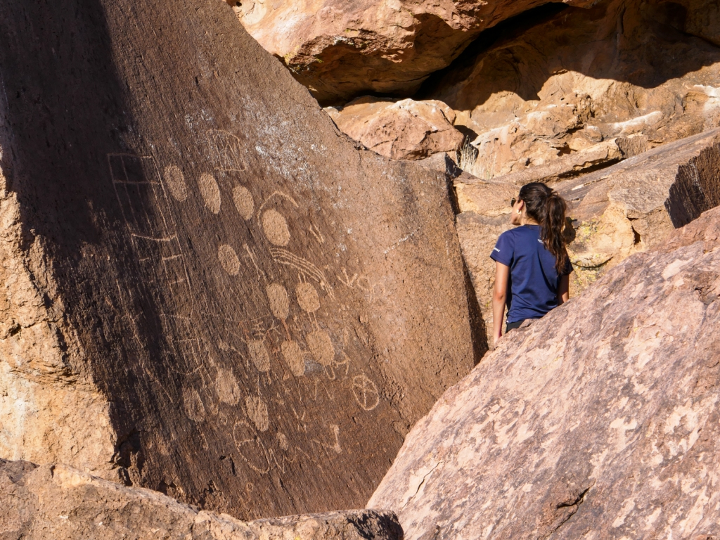 Madison Snively examines petroglyphs on the volcanic tablelands of Bishop, California.